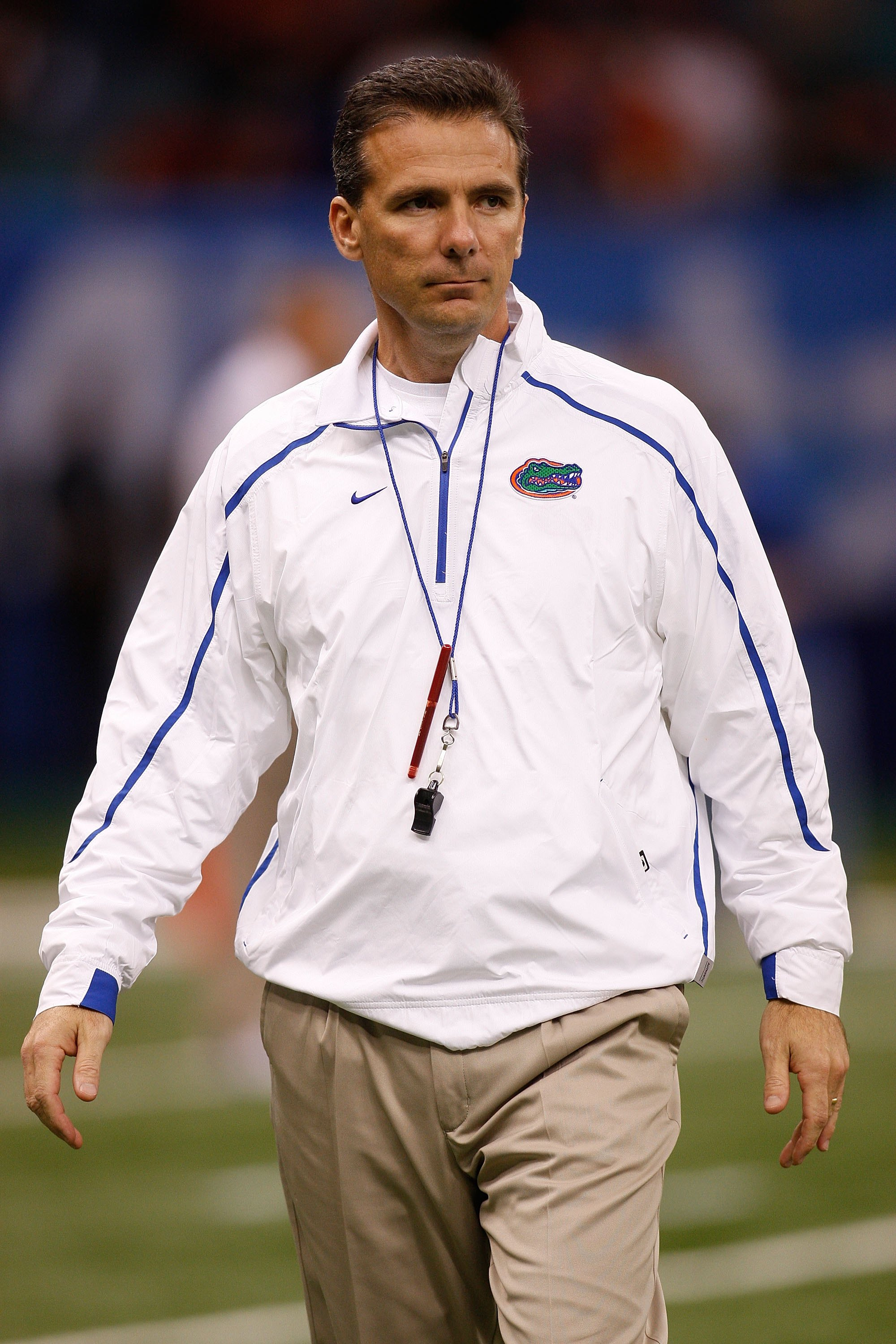 NEW ORLEANS - JANUARY 01:  Head coach Urban Meyer of the Florida Gators watches his team warm up before playing the Cincinnati Bearcats during the Allstate Sugar Bowl at the Louisana Superdome on January 1, 2010 in New Orleans, Louisiana.  (Photo by Chris