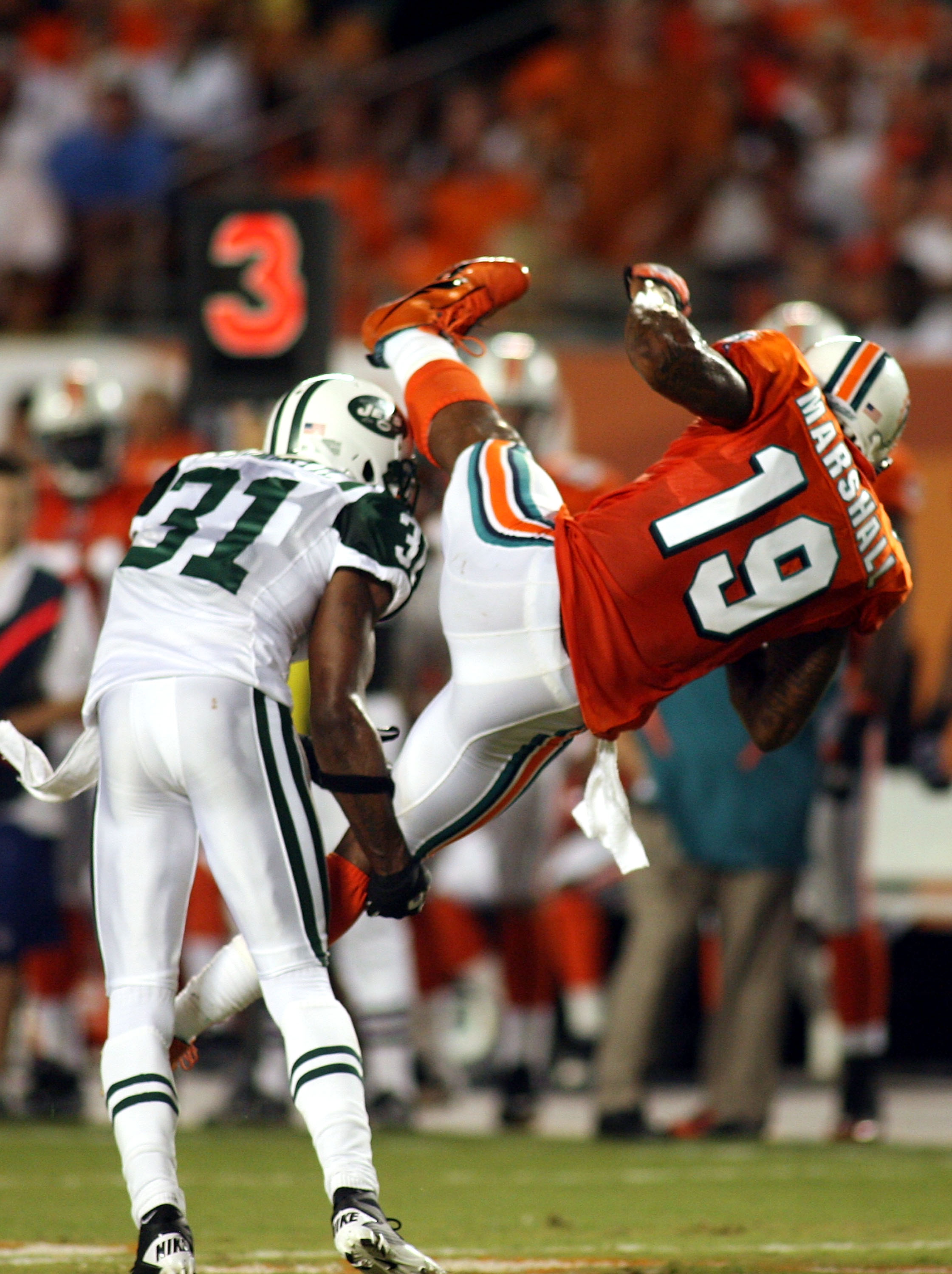 MIAMI - SEPTEMBER 26: Receiver Brandon Marshall #19 of the Miami Dolphins makes a catch against the New York Jets at Sun Life Stadium on September 26, 2010 in Miami, Florida. (Photo by Marc Serota/Getty Images)