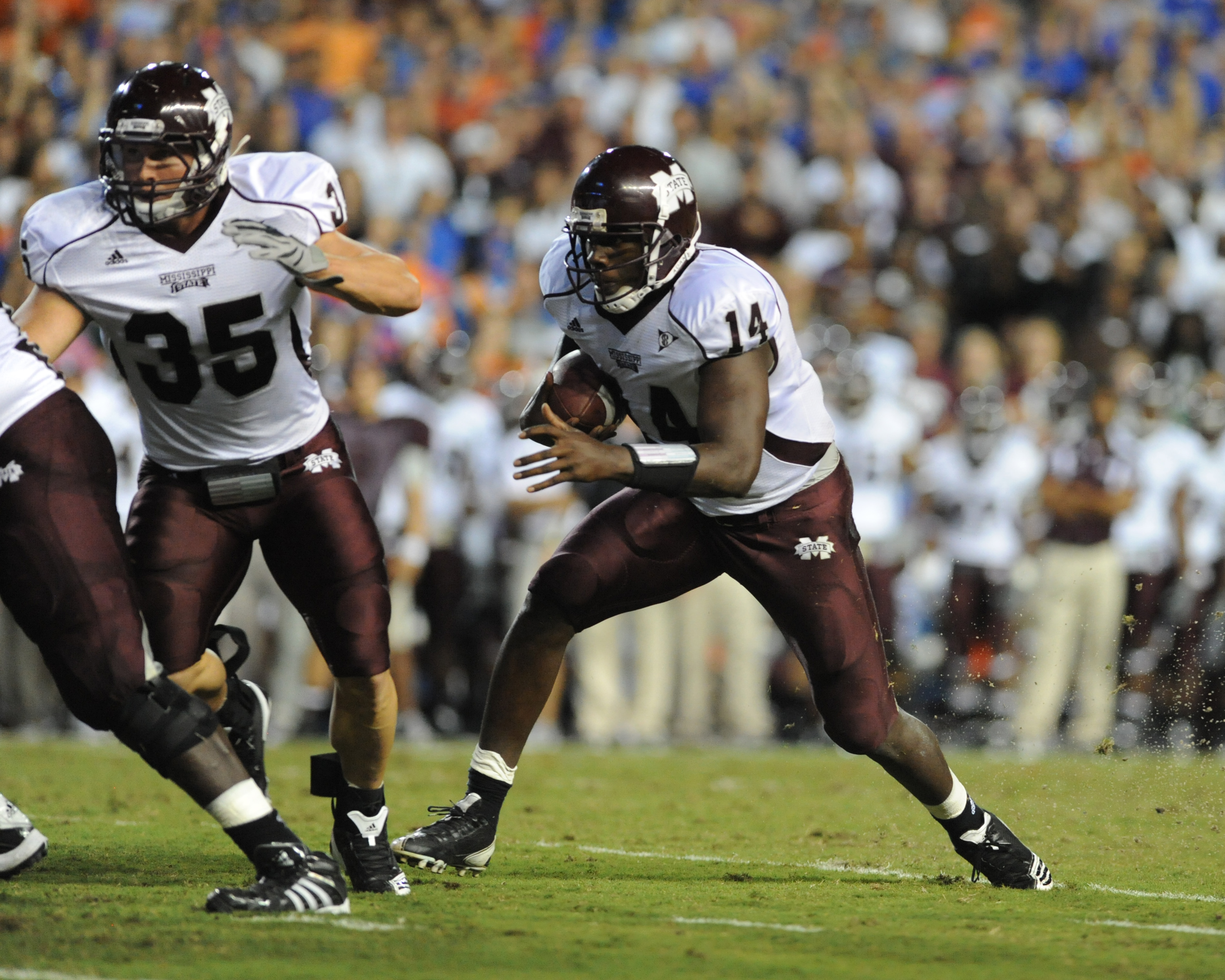 GAINESVILLE, FL - OCTOBER 16:  Quarterback Chris Relf #14 of the Mississippi State Bulldogs runs for a touchdown against the Florida Gators October 16, 2010 Ben Hill Griffin Stadium at Gainesville, Florida.  (Photo by Al Messerschmidt/Getty Images)