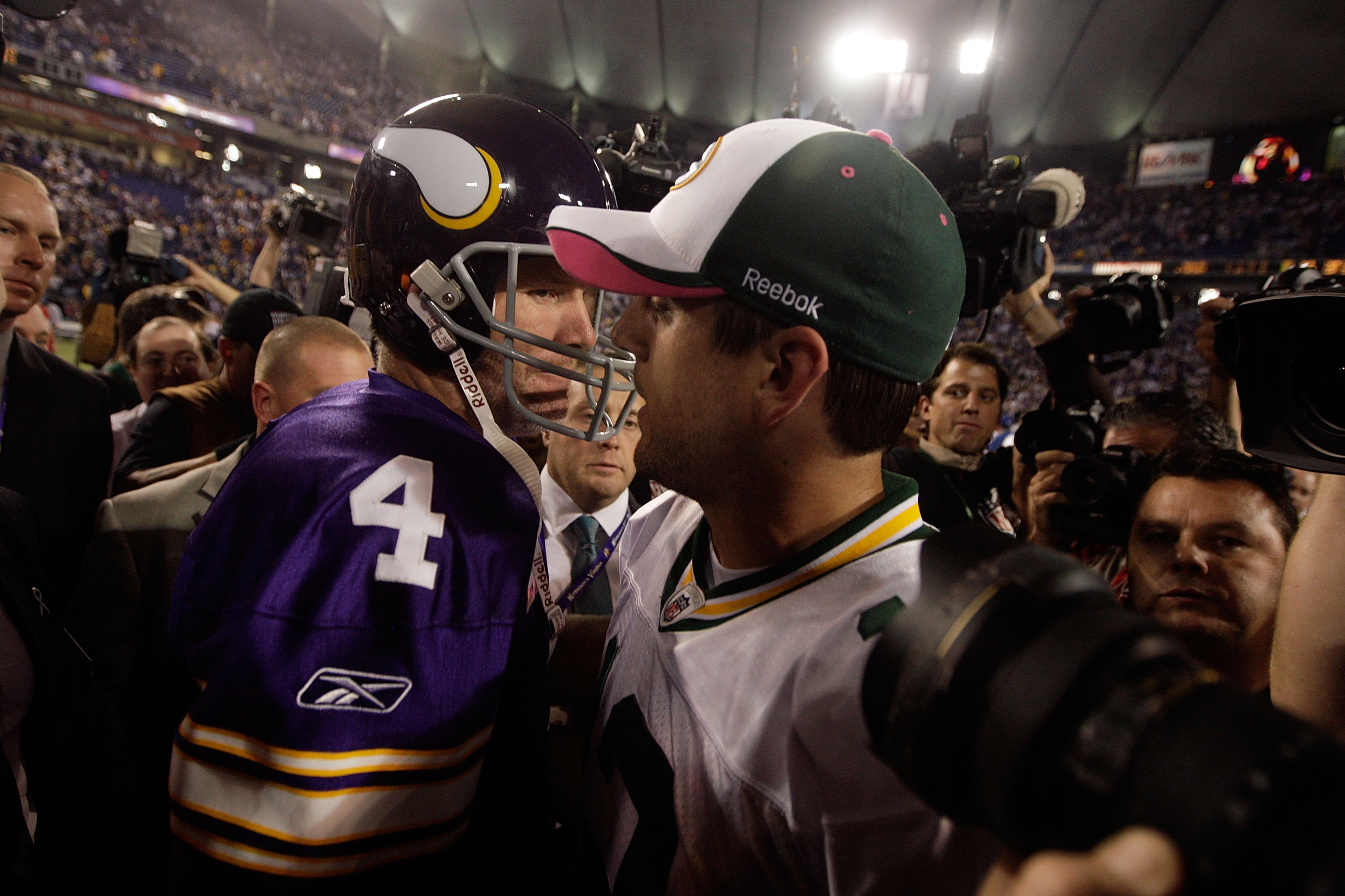 MINNEAPOLIS - OCTOBER 05:  Quarterback Brett Favre #4 of the Minnesota Vikings hugs Aaron Rodgers #12 of the Green Bay Packers following the Vikings victory over the Packers on October 5, 2009 at Hubert H. Humphrey Metrodome in Minneapolis, Minnesota.  (P