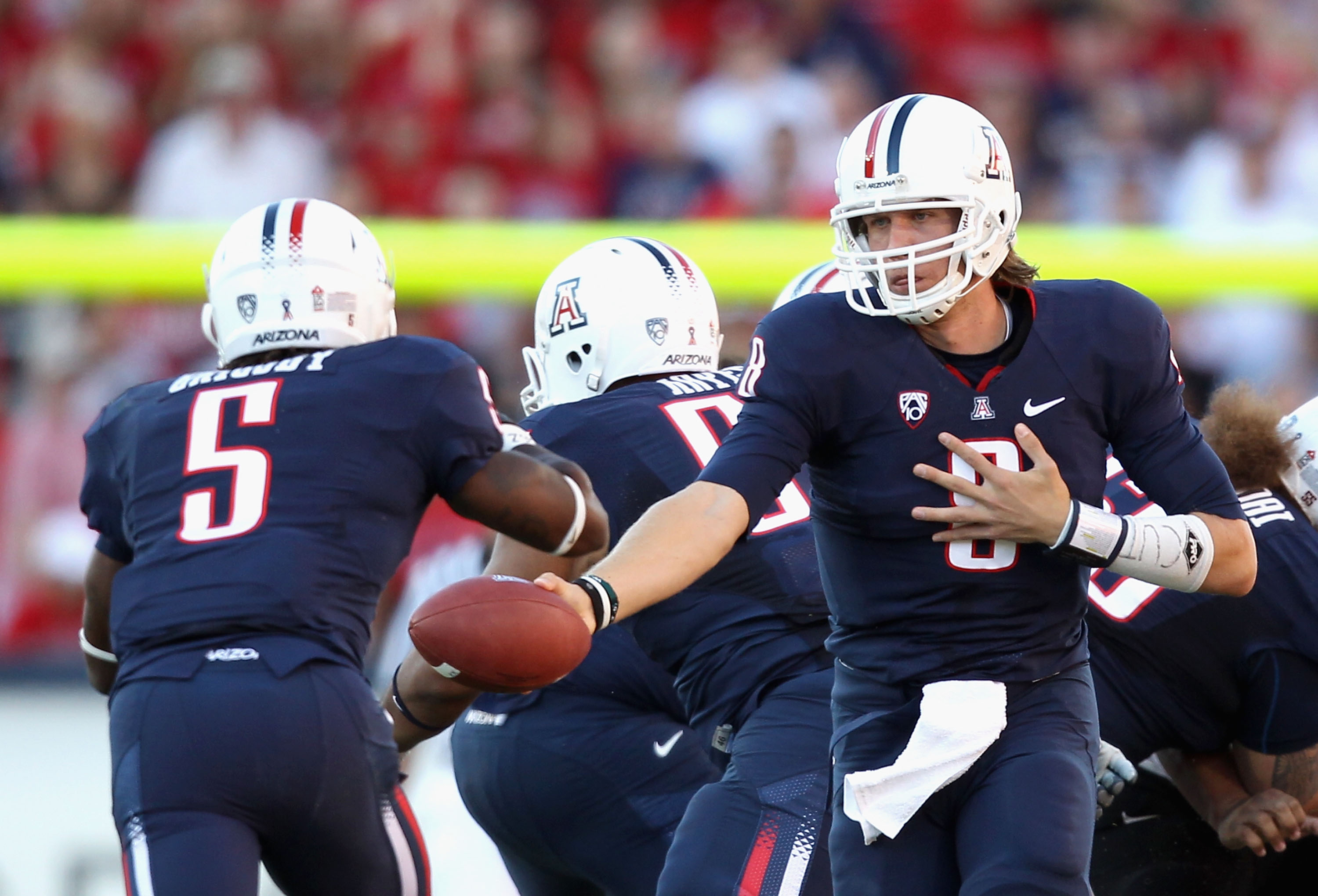 TUCSON, AZ - OCTOBER 09:  Quarterback Nick Foles #8 of the Arizona Wildcats  during the college football game against the Oregon State Beavers at Arizona Stadium on October 9, 2010 in Tucson, Arizona.  The Beavers defeated the Wildcats 29-27.  (Photo by C