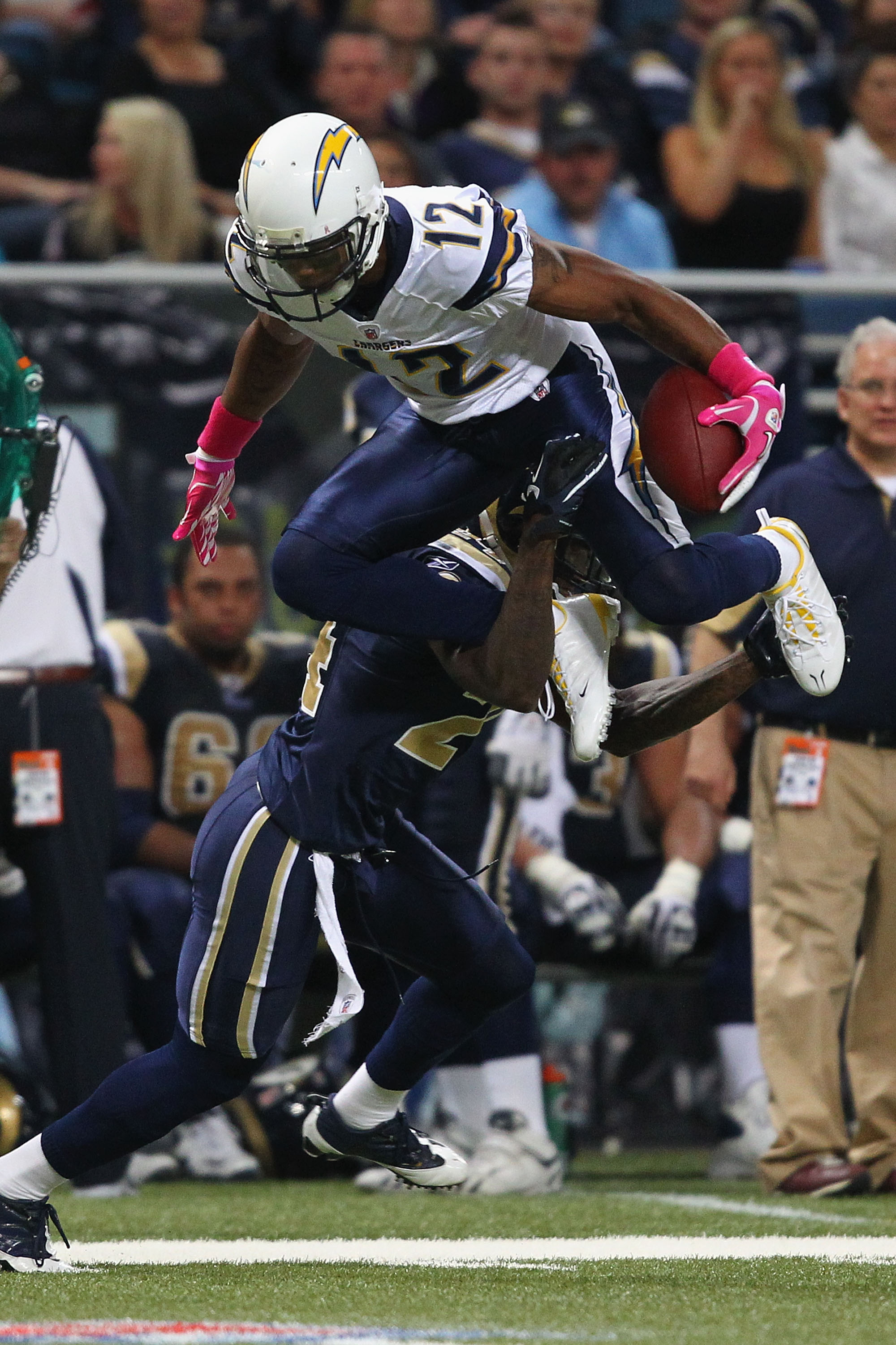 ST. LOUIS - OCTOBER 17: Patrick Crayton #12 of the San Diego Chargers leaps over Ronald Bartell #24 of the St. Louis Rams at the Edward Jones Dome on October 17, 2010 in St. Louis, Missouri.  The Rams beat the Chargers 20-17.  (Photo by Dilip Vishwanat/Ge