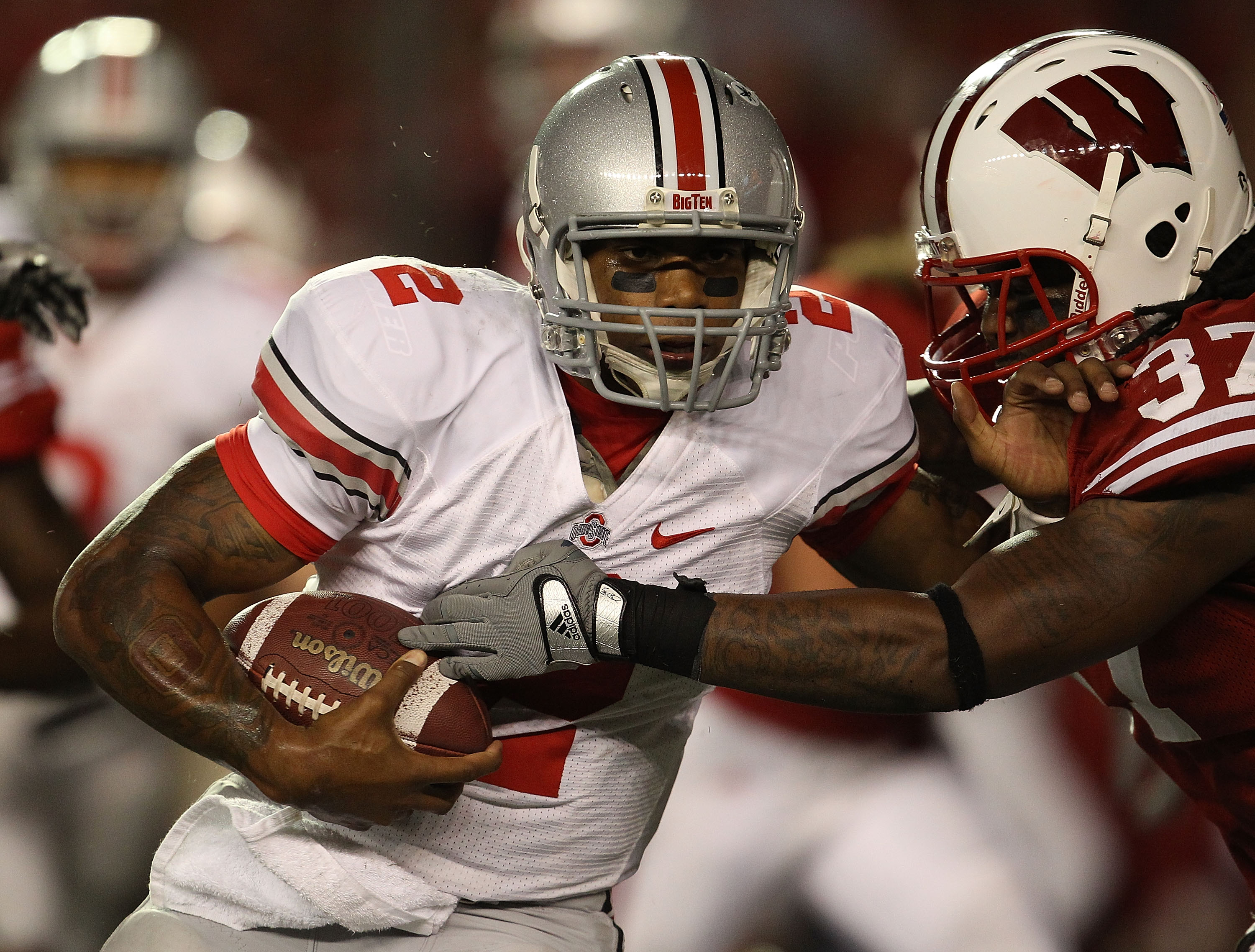 MADISON, WI - OCTOBER 16: Terrelle Pryor #2 of the Ohio State Buckeyes rushes against Kevin Claxton #37 of the Wisconsin Badgers at Camp Randall Stadium on October 16, 2010 in Madison, Wisconsin. Wisconsin defeated Ohio State 31-18.  (Photo by Jonathan Da