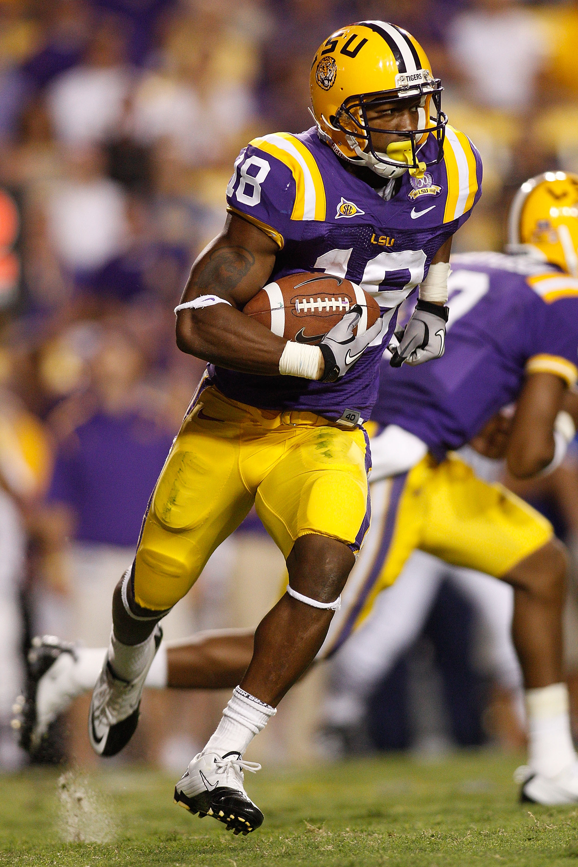 BATON ROUGE, LA - OCTOBER 16:  Richard Murphy #18 of the Louisiana State University Tigers runs the ball against the McNeese State Cowboys at Tiger Stadium on October 16, 2010 in Baton Rouge, Louisiana.  (Photo by Chris Graythen/Getty Images)