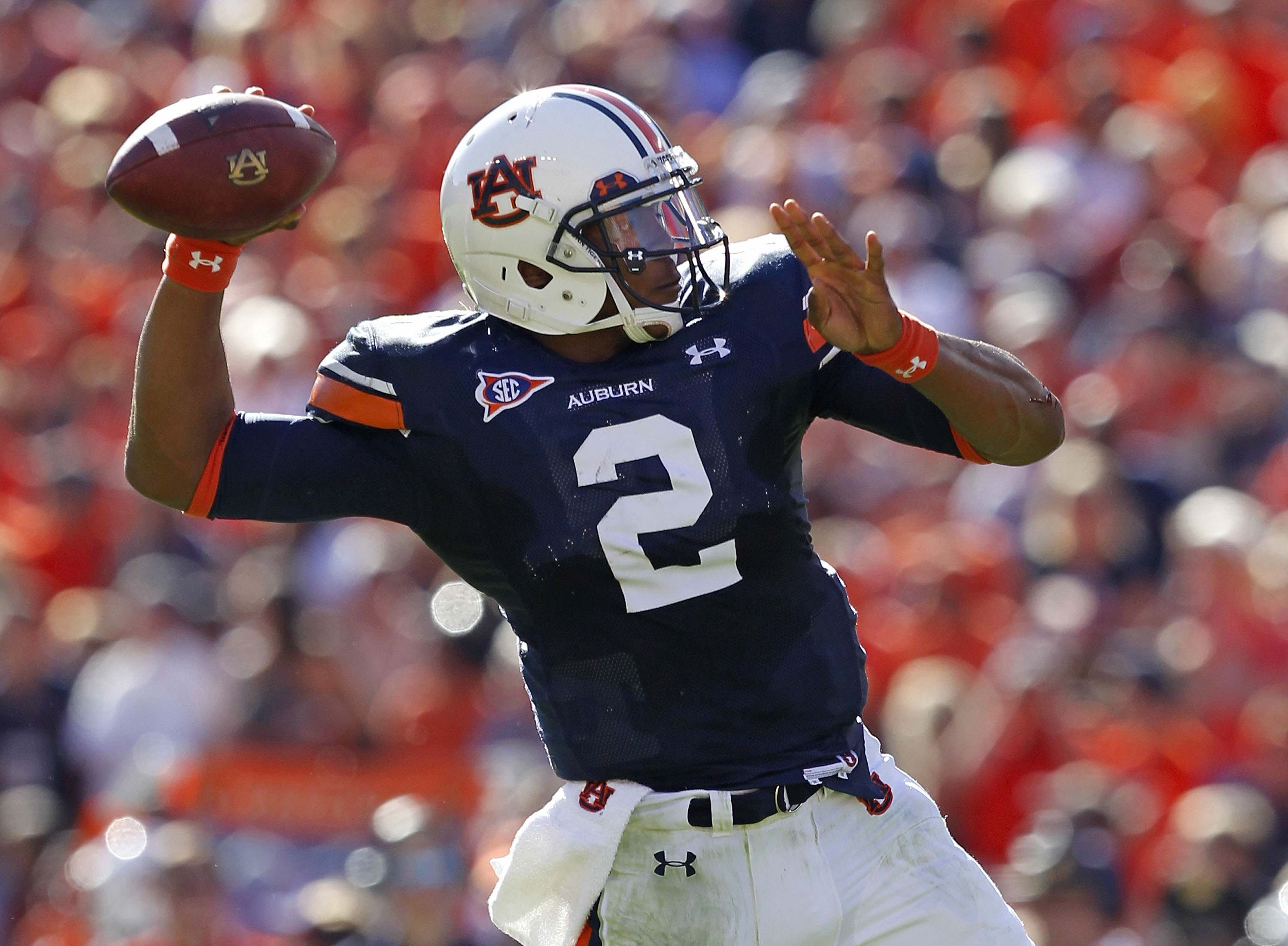 AUBURN, AL - OCTOBER 16:  Quarterback Cam Newton #2 of the Auburn Tigers throws a pass during the game against the Arkansas Razorbacks at Jordan-Hare Stadium on October 16, 2010 in Auburn, Alabama.  (Photo by Mike Zarrilli/Getty Images)