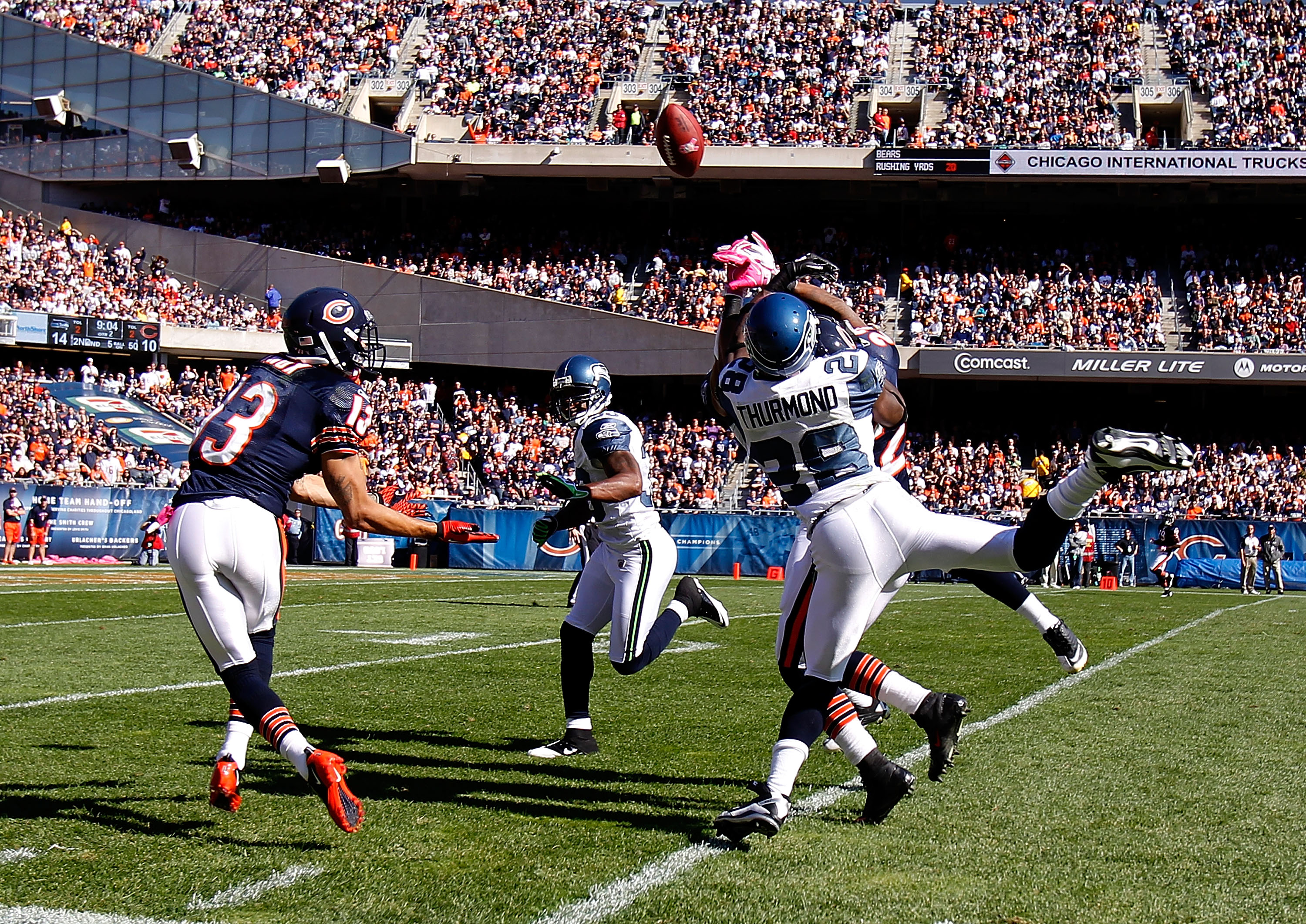 CHICAGO - OCTOBER 17: Walter Thurmond #38 of the Seattle Seahawks breaks up a pass intended for Devin Hester #23 of the Chicago Bears as Johnny Knox #13 attempts a catch at Soldier Field on October 17, 2010 in Chicago, Illinois. The Seahawks defeated the