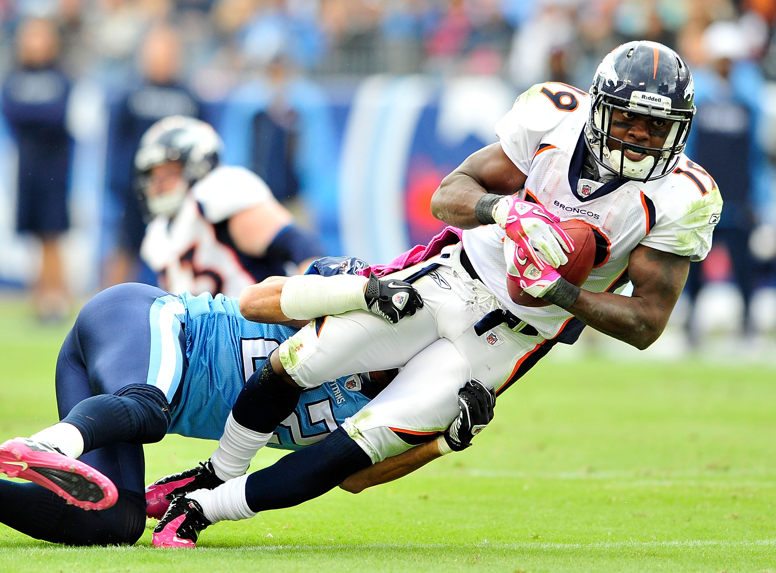 NASHVILLE, TN - OCTOBER 03:  Vincent Fuller #22 of the Tennessee Titans tackles Eddie Royal #19 of the Denver Broncos during the first half at LP Field on October 3, 2010 in Nashville, Tennessee.  (Photo by Grant Halverson/Getty Images)