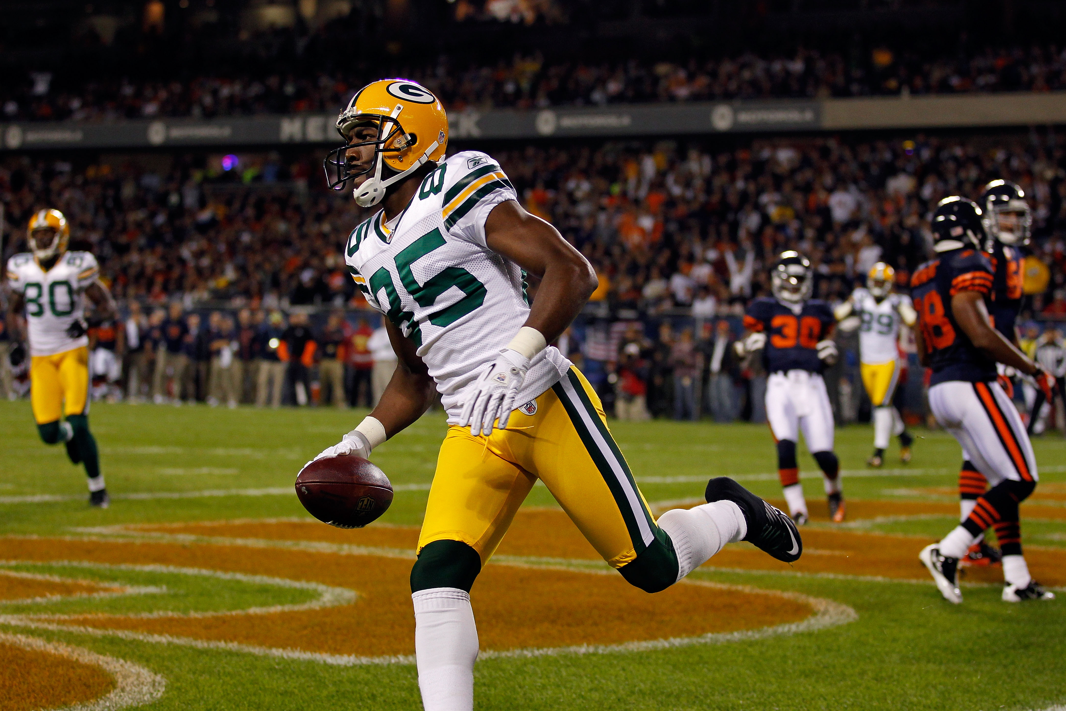 CHICAGO - SEPTEMBER 27:  Greg Jennings #85 of the Green Bay Packers reacts after he scored a 7-yard touchdown reception in the first quarter against the Chicago Bears at Soldier Field on September 27, 2010 in Chicago, Illinois.  (Photo by Jonathan Daniel/
