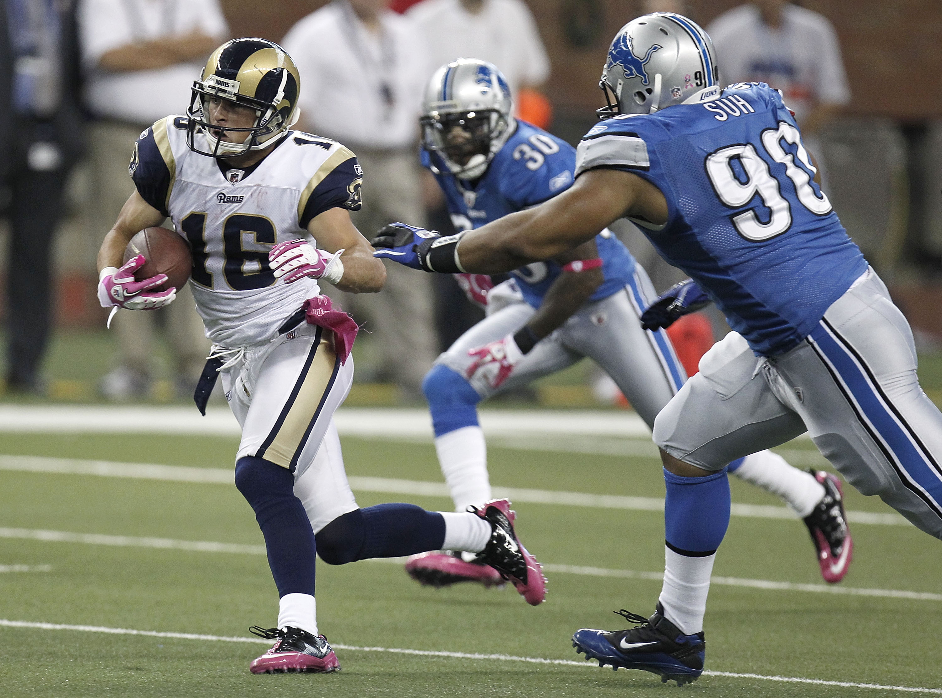 DETROIT - OCTOBER 10: Danny Amendola #16 of the St. Louis Rams tries to outrun the tackle of Ndamukong Suh #90 of the Detroit Lions on October 10, 2010 at Ford Field in Detroit, Michigan.  (Photo by Gregory Shamus/Getty Images)
