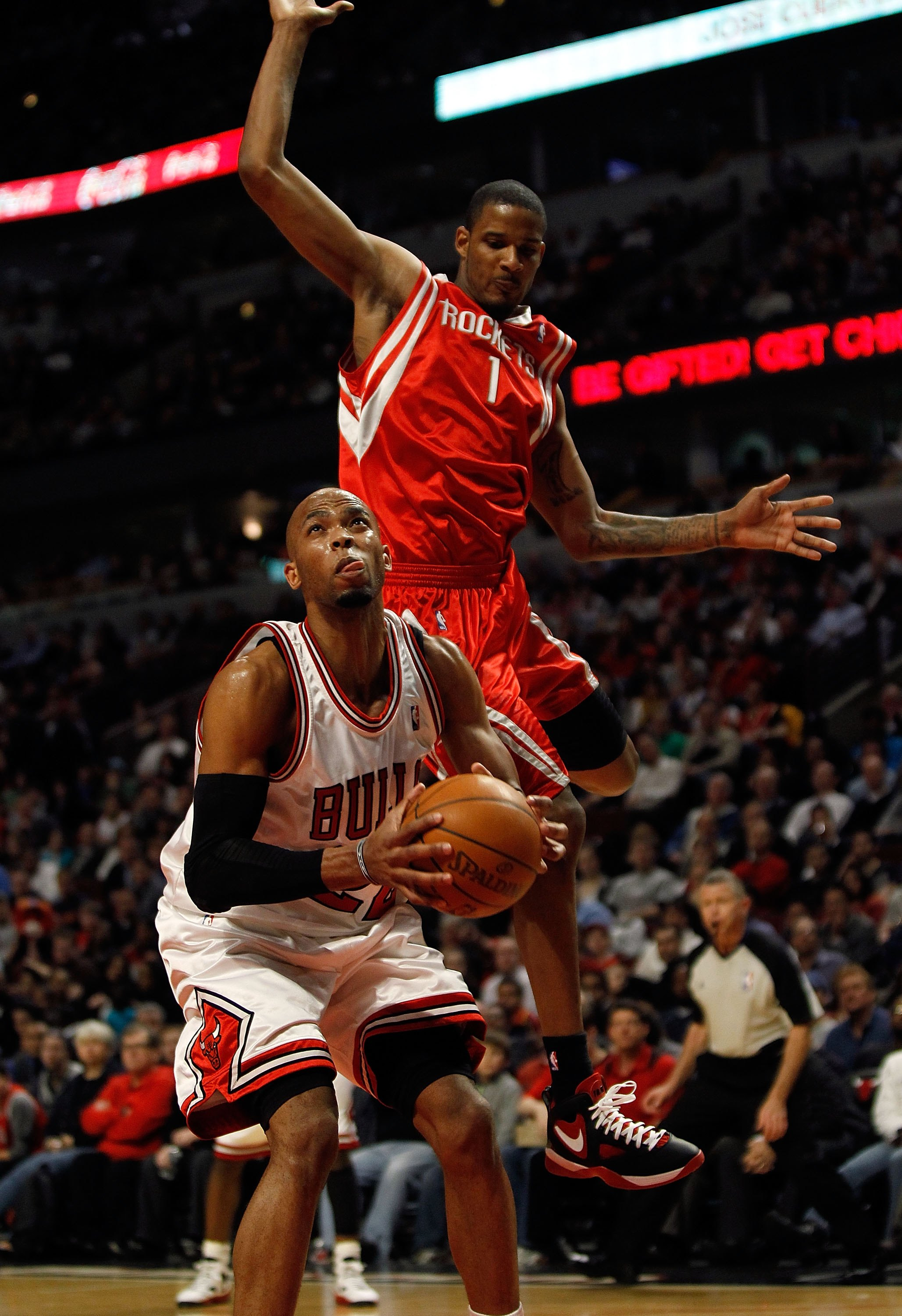 CHICAGO - MARCH 22: Taj Gibson #22 of the Chicago Bulls tries to shoot as Trevor Ariza #1 of the Houston Rockets leaps behind him at the United Center on March 22, 2010 in Chicago, Illinois. The Bulls defeated the Rockets 98-88. NOTE TO USER: User express