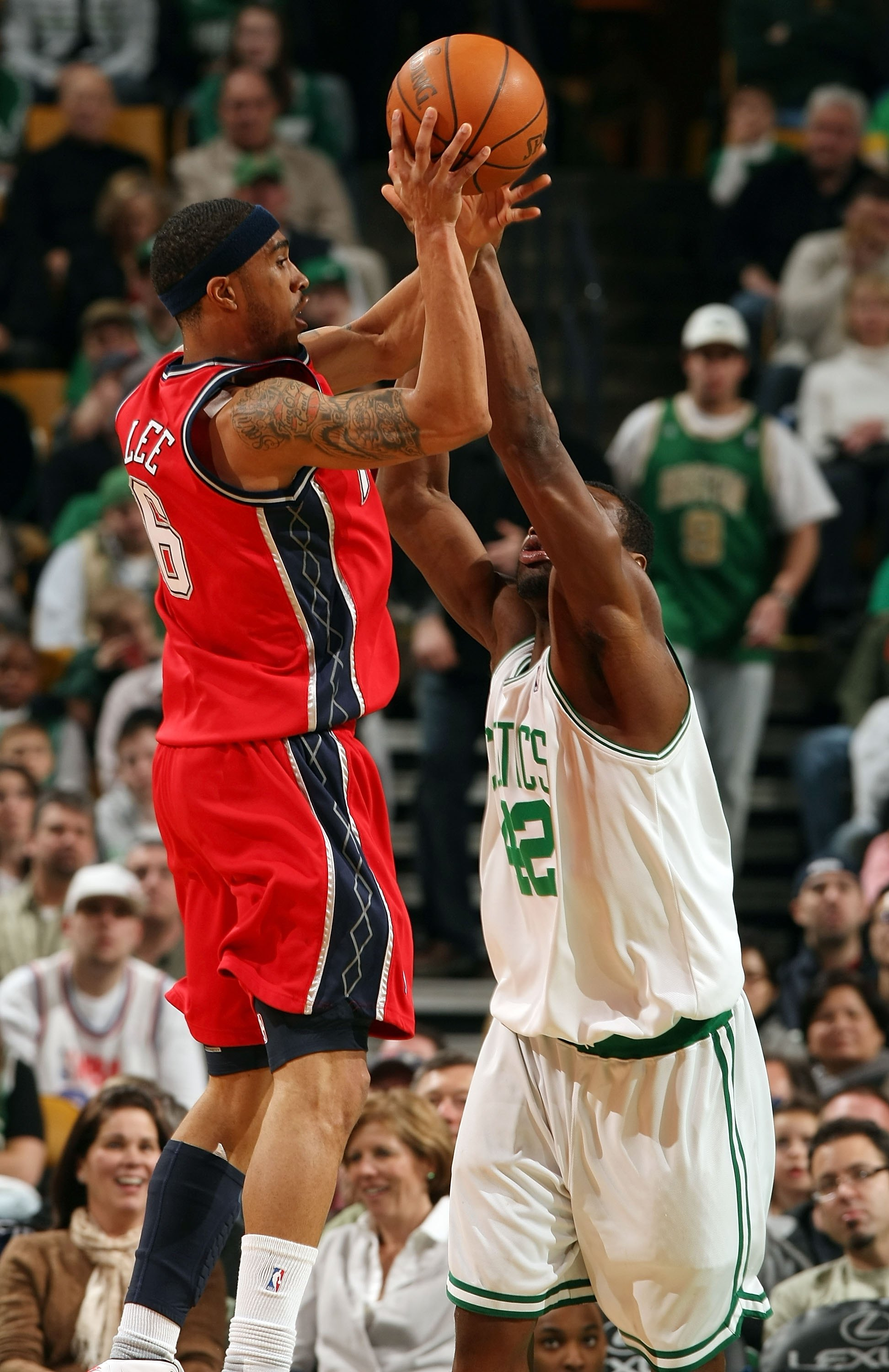 BOSTON - FEBRUARY 27:  Courtney Lee #6 of the New Jersey Nets takes a shot as Tony Allen #42 of the Boston Celtics defends at the TD Garden on February 27, 2010 in Boston, Massachusetts. The Nets defeated the Celtics 104-96.  NOTE TO USER: User expressly