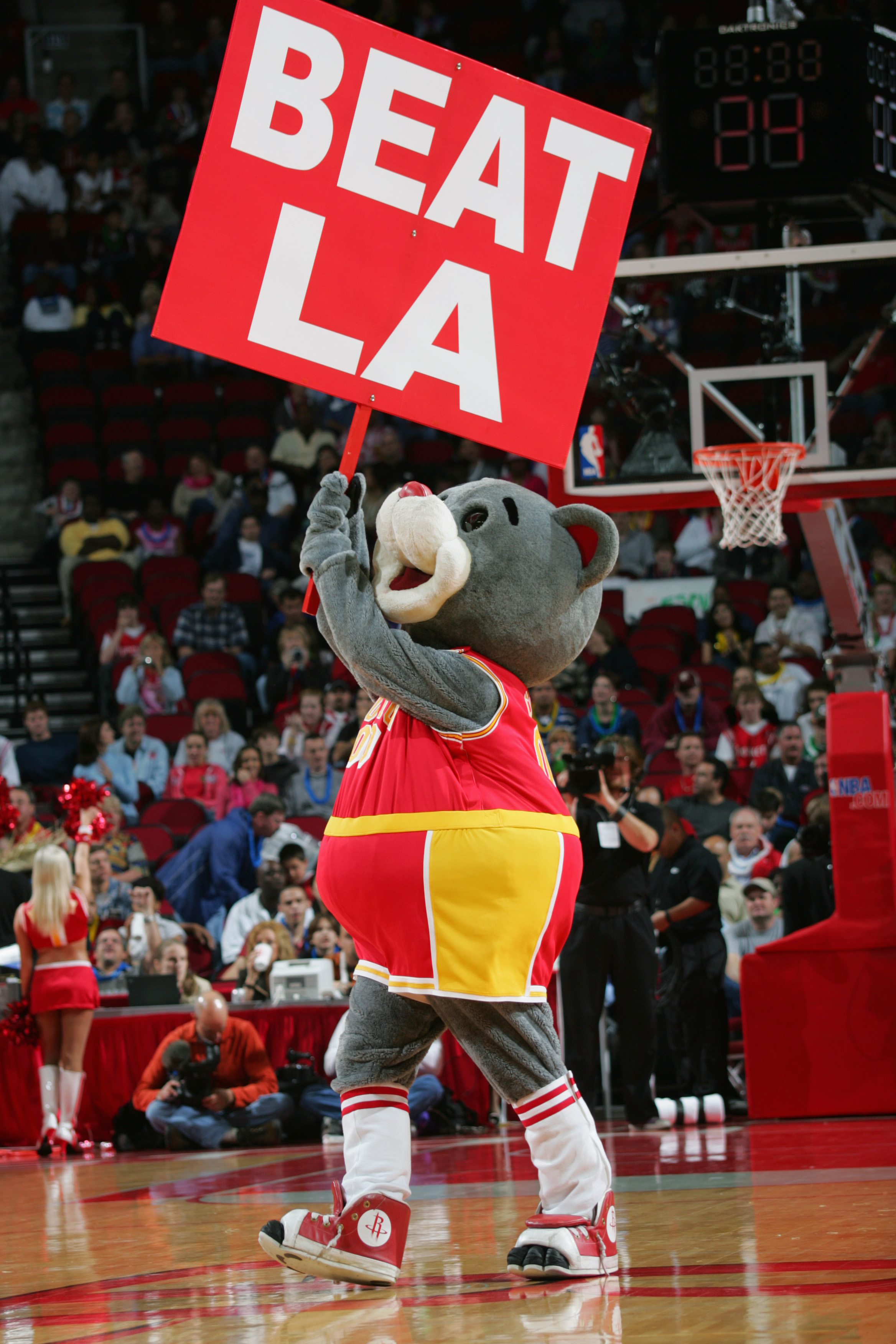 HOUSTON - FEBRUARY 6:  Clutch, the Houston Rockets mascot, hols a 'Beat LA' sign during the game against the Los Angeles Lakers on February 6, 2005 at the Toyota Center in Houston, Texas.  The Rockets won 103-102.  NOTE TO USER: User expressly acknowledge