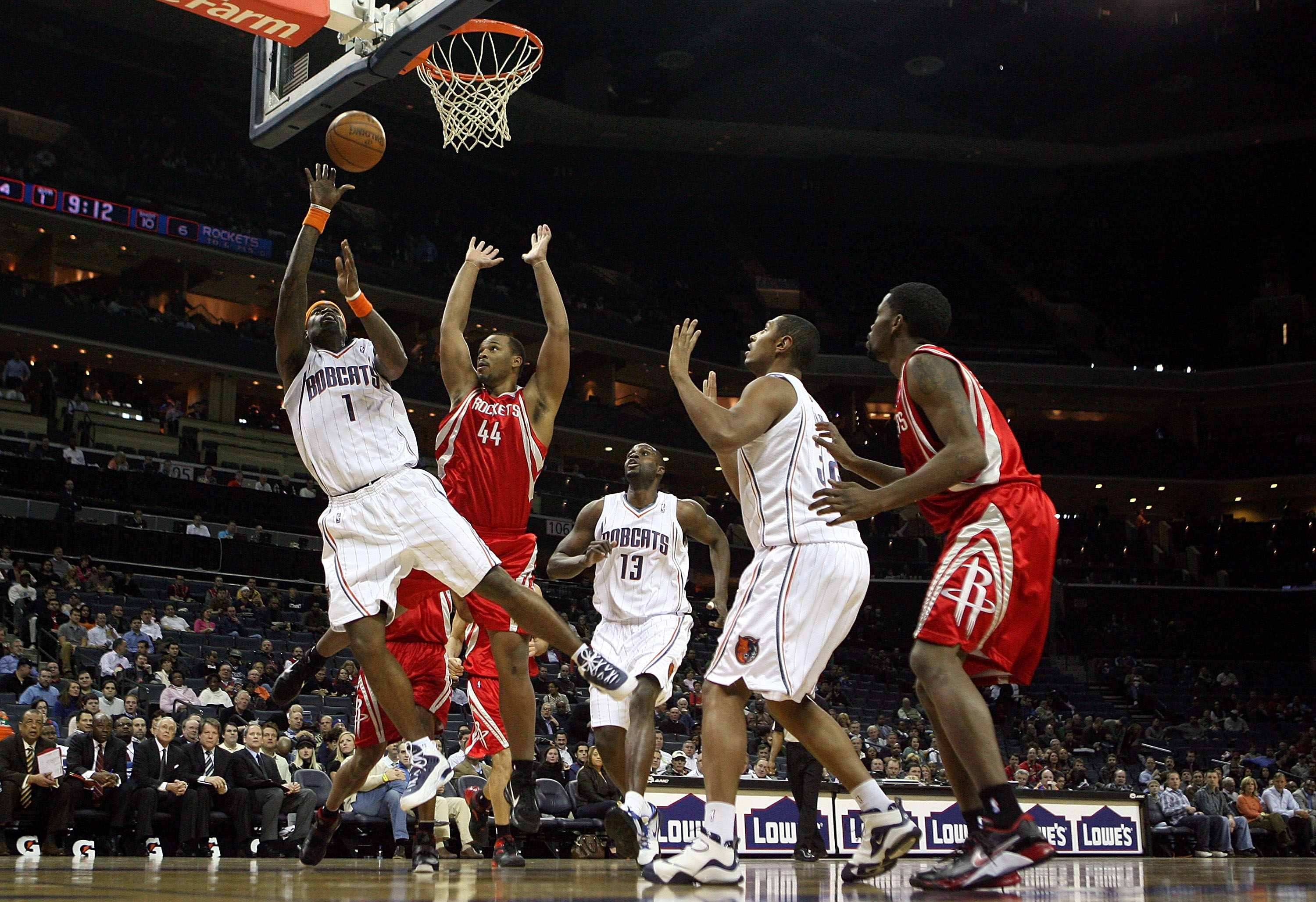 CHARLOTTE, NC - JANUARY 12:  Chuck Hayes #44 of the Houston Rockets watches as Stephen Jackson #1 of the Charlotte Bobcats goes to the basket at Time Warner Cable Arena on January 12, 2010 in Charlotte, North Carolina.  NOTE TO USER: User expressly acknow