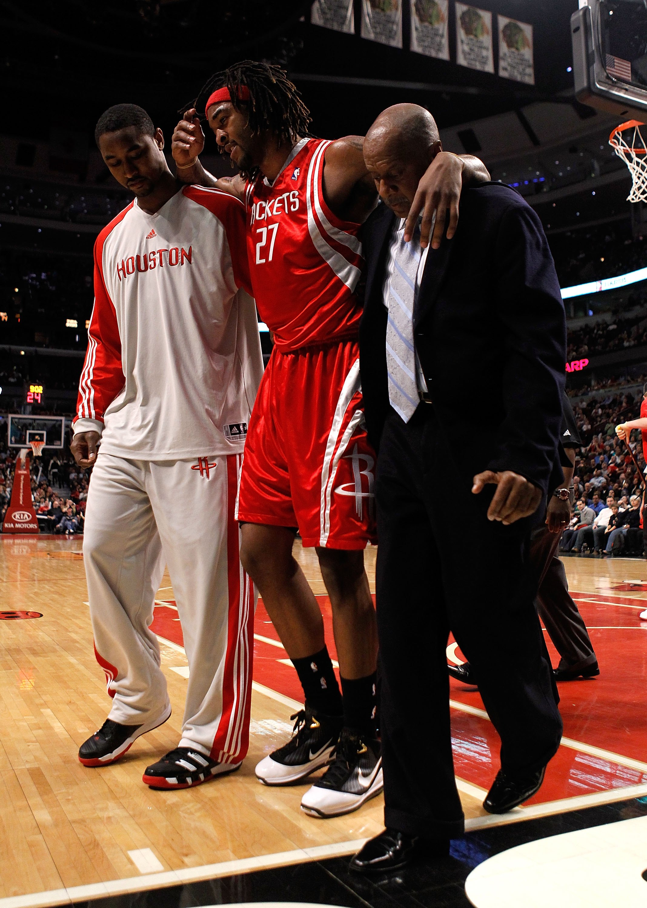CHICAGO - MARCH 22: Jordan Hill #27 of the Houston Rockets is helped off the court after injuring his leg against the Chicago Bulls at the United Center on March 22, 2010 in Chicago, Illinois. The Bulls defeated the Rockets 98-88. NOTE TO USER: User expre