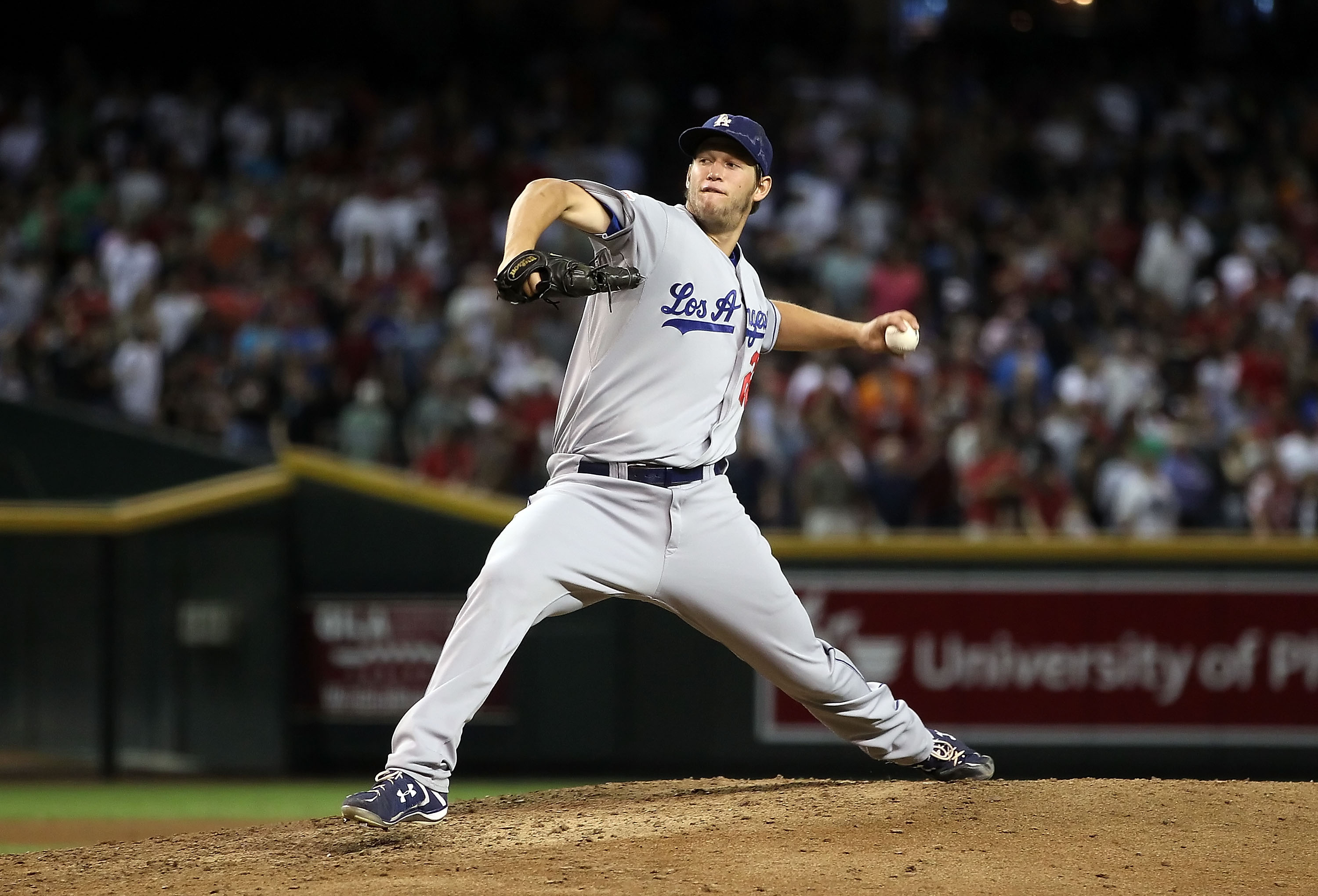PHOENIX - SEPTEMBER 24:  Starting pitcher Clayton Kershaw #22 of the Los Angeles Dodgers pitches against the Arizona Diamondbacks during the Major League Baseball game at Chase Field on September 24, 2010 in Phoenix, Arizona.  (Photo by Christian Petersen