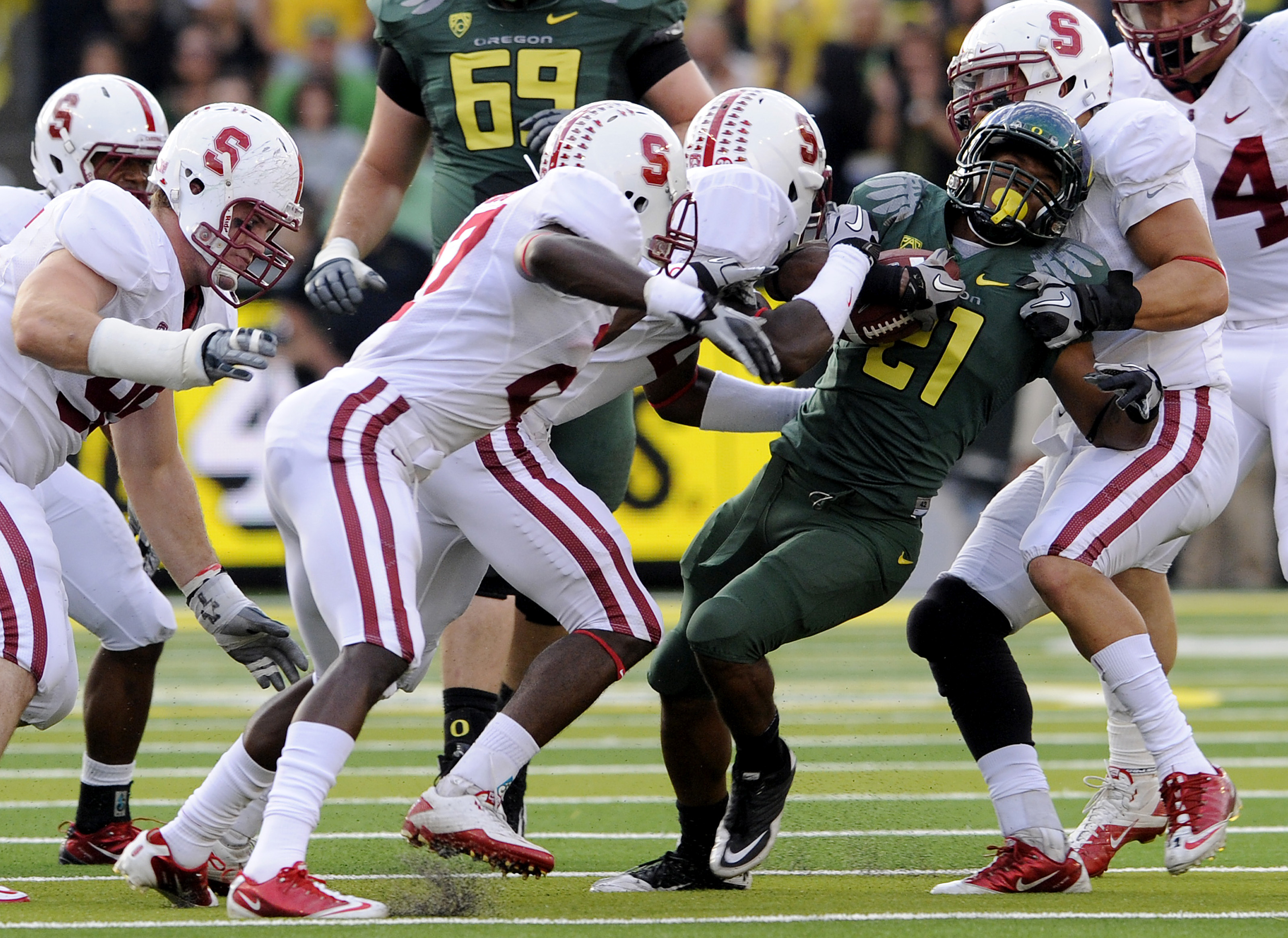EUGENE, OR - OCTOBER 2: Stanford Cardinal defenders struggle to bring down running back LaMichael James #21 of the Oregon Ducks celebrates as he scores a touchdown in the second quarter of the game against the Stanford Cardinal at Autzen Stadium on Octobe