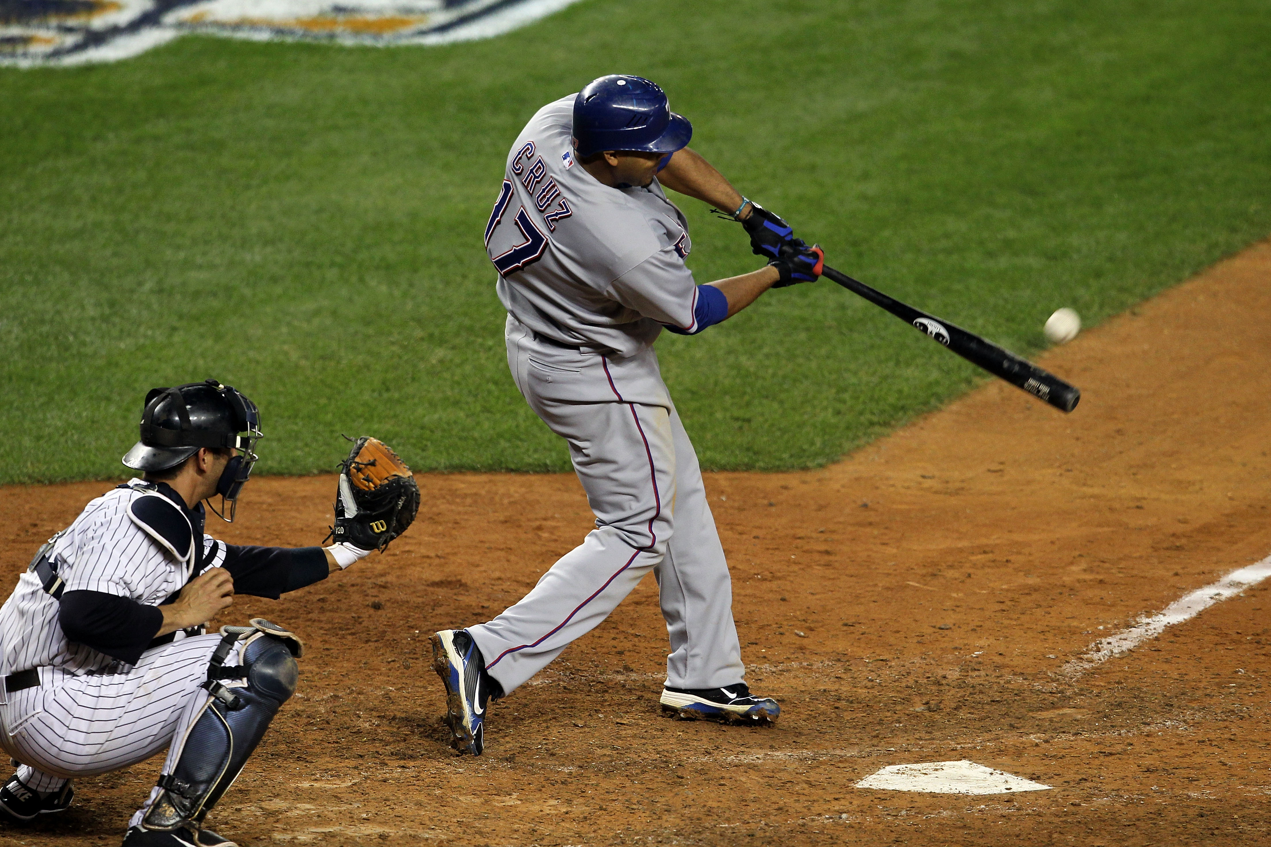 NEW YORK - OCTOBER 19:  Nelson Cruz #17 of the Texas Rangers hits a 2-run home run in the bottom of the ninth inning against the New York Yankees  in Game Four of the ALCS during the 2010 MLB Playoffs at Yankee Stadium on October 19, 2010 in the Bronx bor