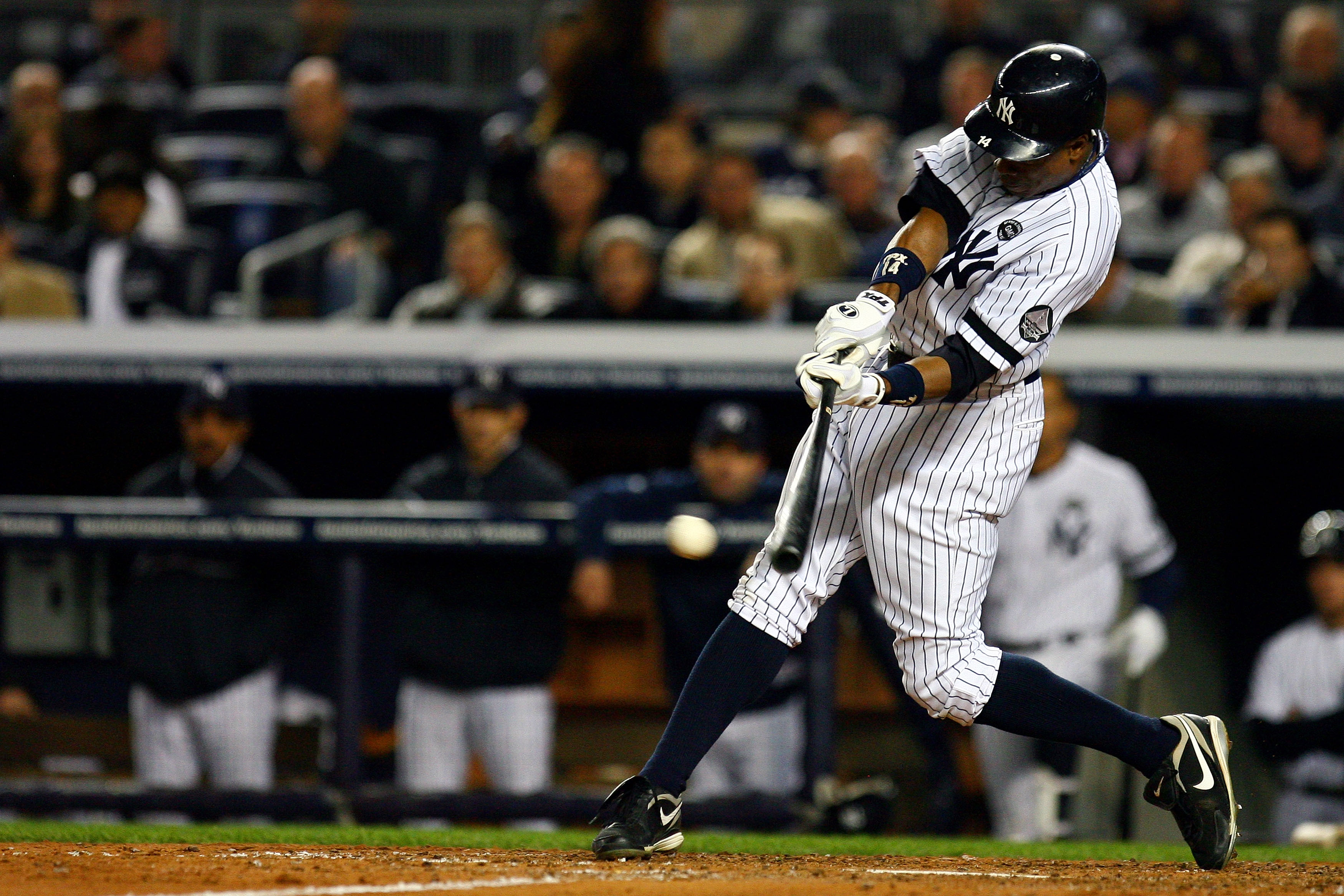 NEW YORK - OCTOBER 19:  Curtis Granderson #14 of the New York Yankees hits an RBI single in the third inning against the Texas Rangers in Game Four of the ALCS during the 2010 MLB Playoffs at Yankee Stadium on October 19, 2010 in the Bronx borough of New