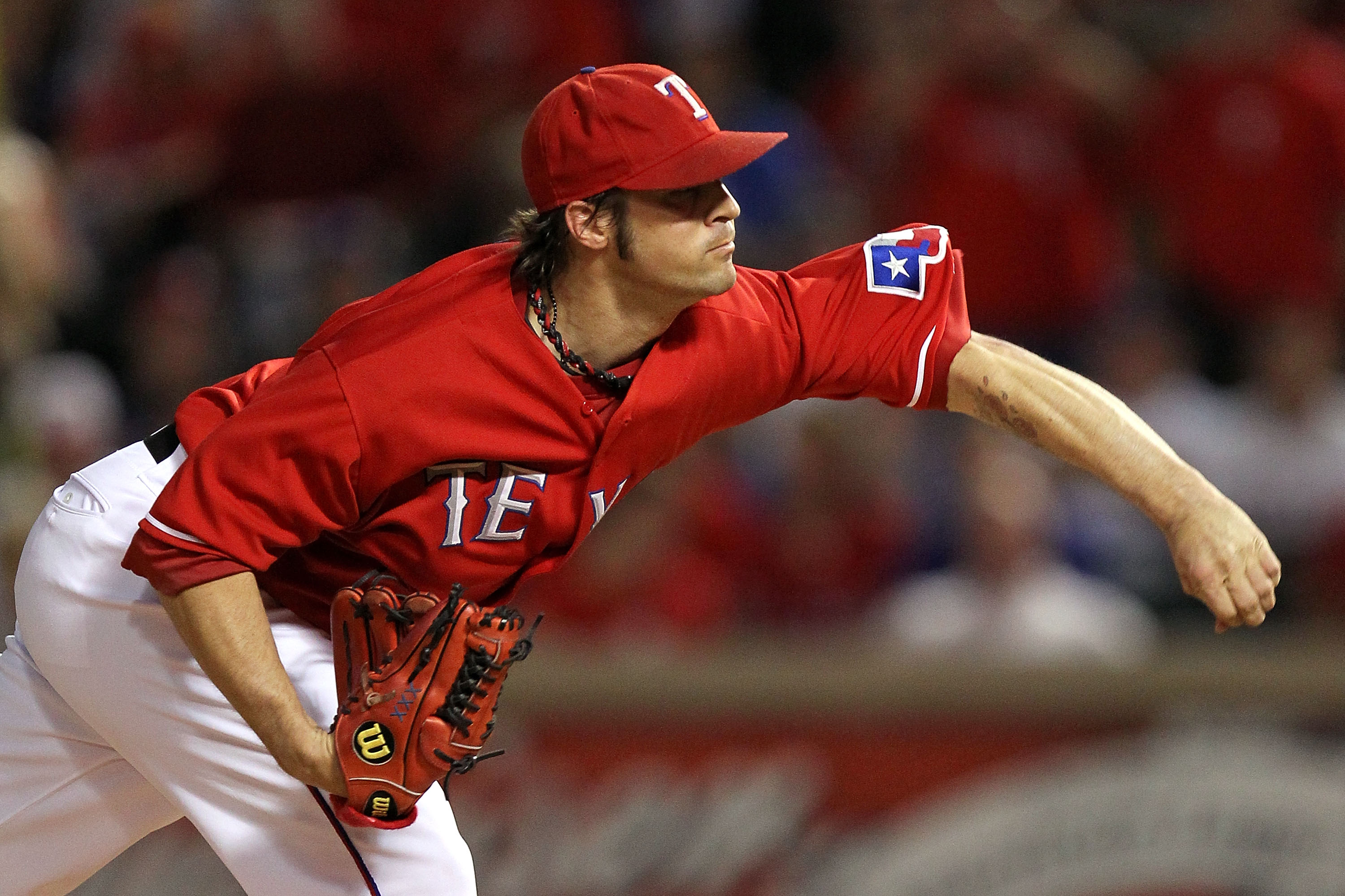 ARLINGTON, TX - OCTOBER 15:  Starting pitcher C.J. Wilson #36 of the Texas Rangers pitches against the New York Yankees in Game One of the ALCS during the 2010 MLB Playoffs at Rangers Ballpark in Arlington on October 15, 2010 in Arlington, Texas. The Yank