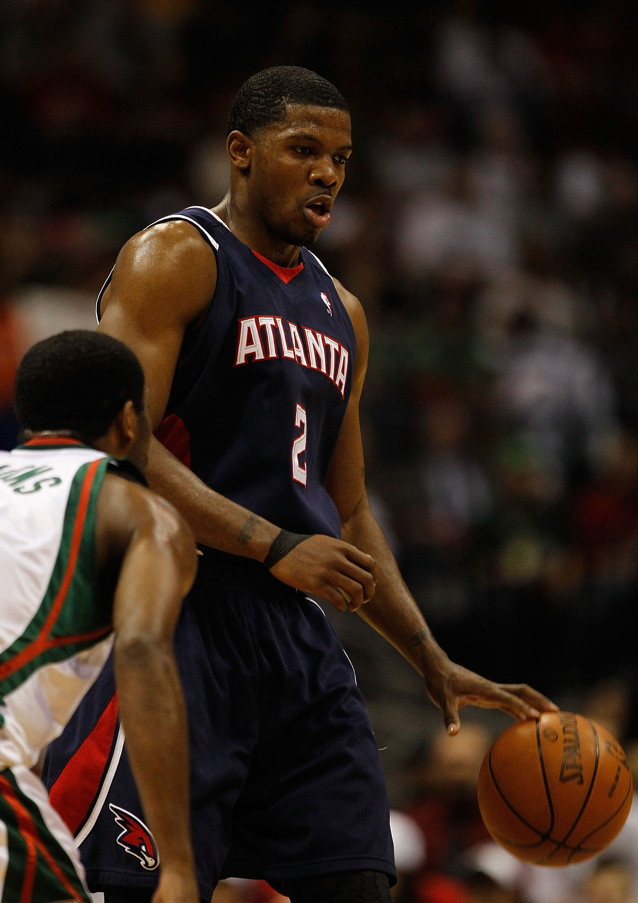 MILWAUKEE - APRIL 30: Joe Johnson #2 of the Atlanta Hawks dribbles with ball agaiunst the Milwaukee Bucks in Game Six of the Eastern Conference Quarterfinals during the 2010 NBA Playoffs at the Bradley Center on April 30, 2010 in Milwaukee, Wisconsin. The