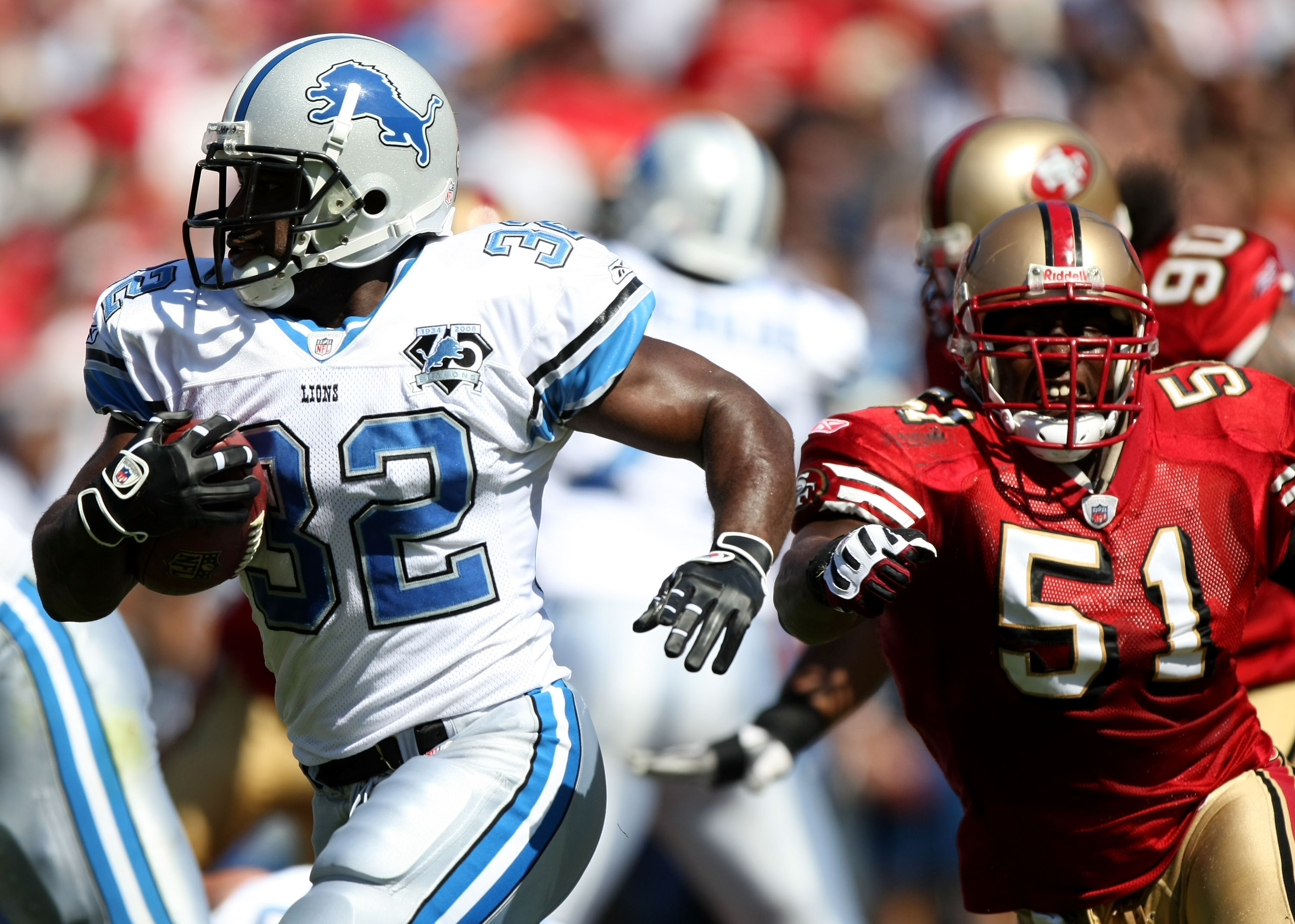SAN FRANCISCO - SEPTEMBER 21: Rudi Johnson #32 of the Detroit Lions runs against Takeo Spikes #51 of the San Francisco 49ers during an NFL game on September 21, 2008 at Candlestick Park in San Francisco, California.  (Photo by Jed Jacobsohn/Getty Images)