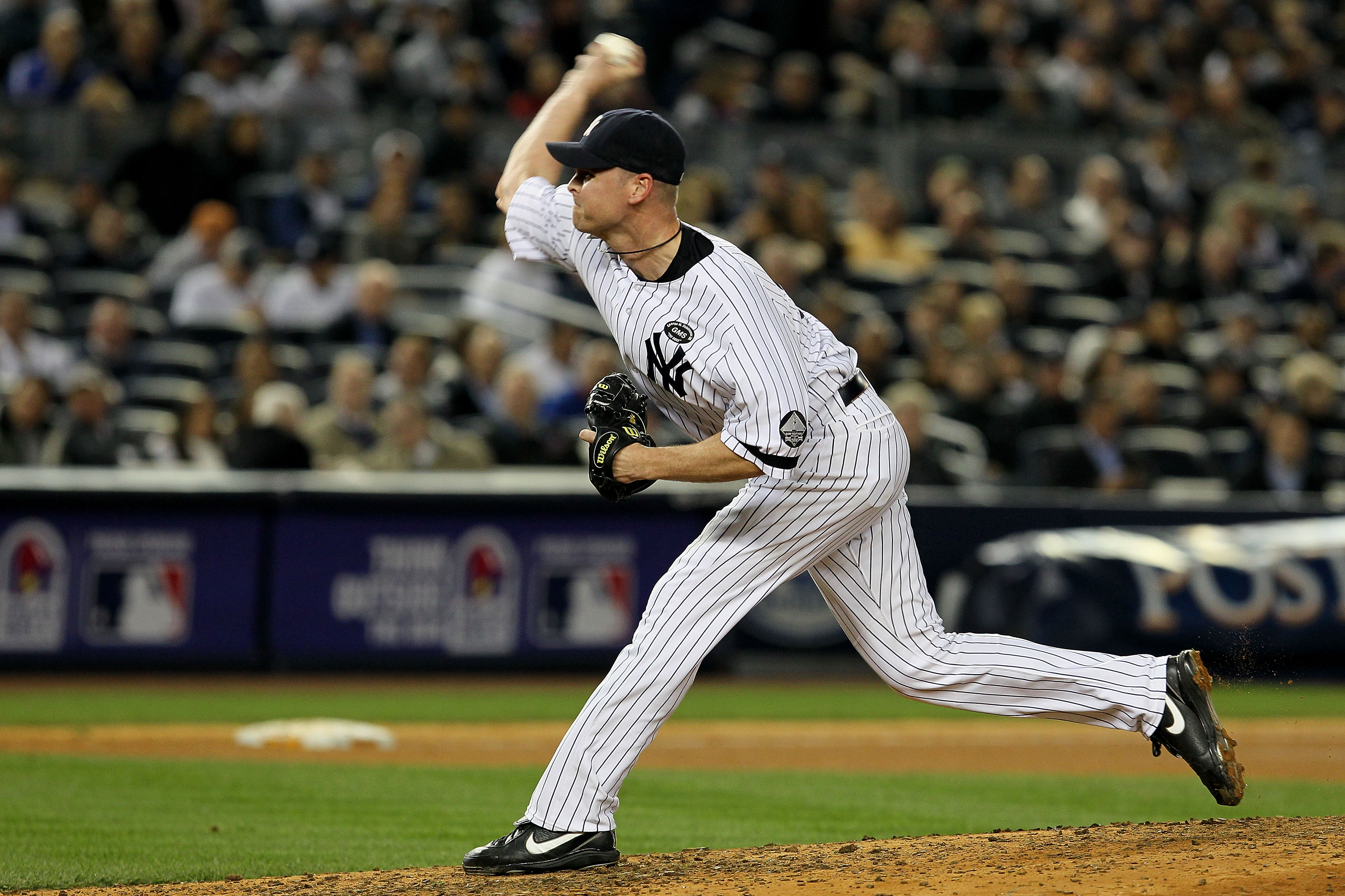 NEW YORK - OCTOBER 20:  Kerry Wood #39 of the New York Yankees pitches against the Texas Rangers in Game Five of the ALCS during the 2010 MLB Playoffs at Yankee Stadium on October 20, 2010 in the Bronx borough of New York City.  (Photo by Jim McIsaac/Gett