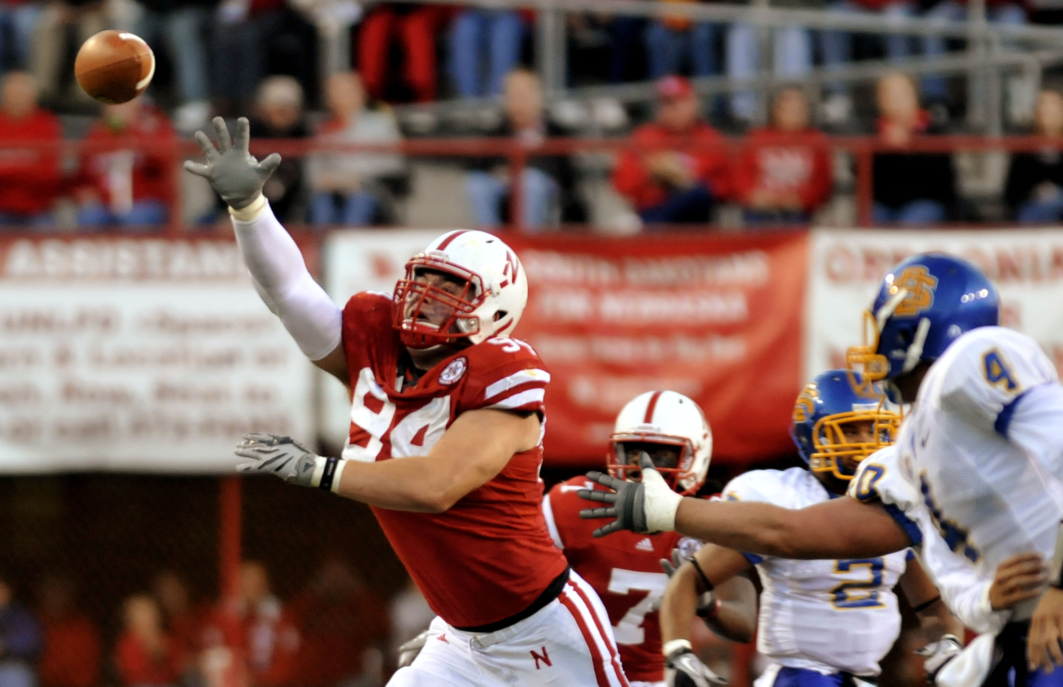 LINCOLN, NE - SEPTEMBER 25: Defensive tackle Jared Crick #94 of the Nebraska Cornhuskers tries to bat down a pass from  quarterback Thomas O'Brien #4 of the South Dakota State Jackrabbits during first half action of their game at Memorial Stadium on Septe