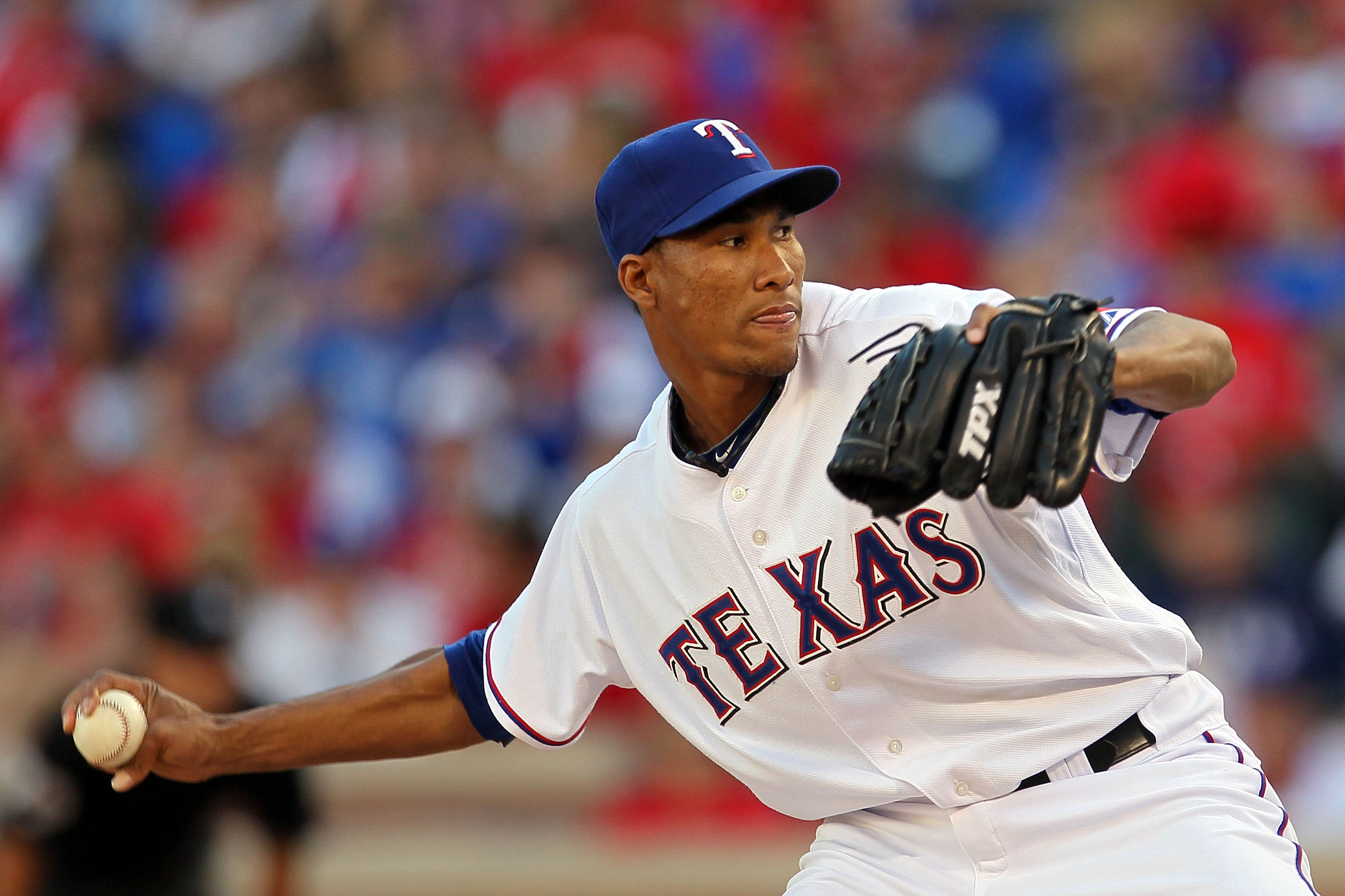 ARLINGTON, TX - OCTOBER 16:  Alexi Ogando #64 of the Texas Rangers pitches against the New York Yankees in Game Two of the ALCS during the 2010 MLB Playoffs at Rangers Ballpark in Arlington on October 16, 2010 in Arlington, Texas.  (Photo by Stephen Dunn/