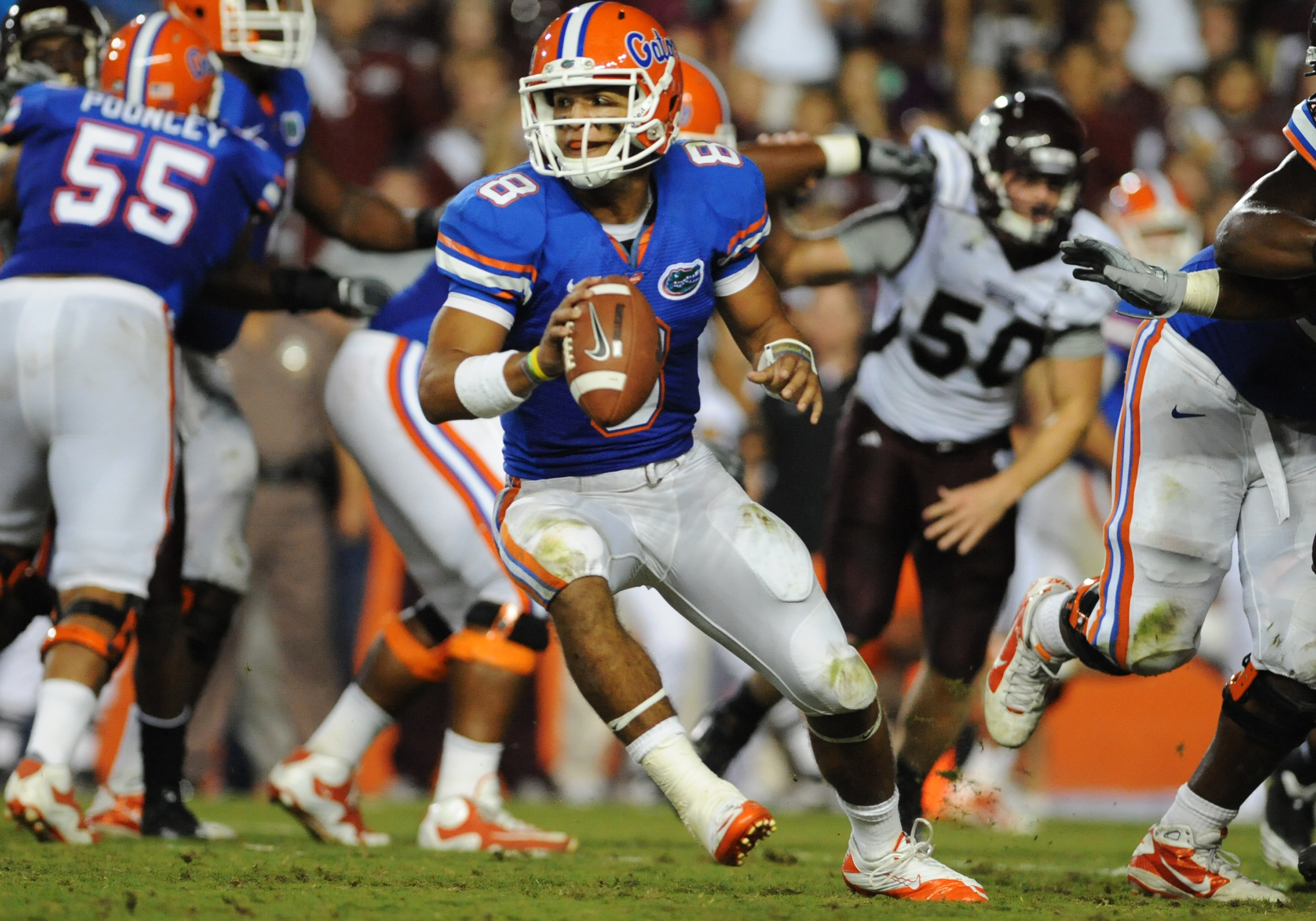 GAINESVILLE, FL - OCTOBER 16:  Quarterback Trey Burton #8 of the Florida Gators looks to lateral against the Mississippi State Bulldogs  October 16, 2010 Ben Hill Griffin Stadium at Gainesville, Florida.  (Photo by Al Messerschmidt/Getty Images)