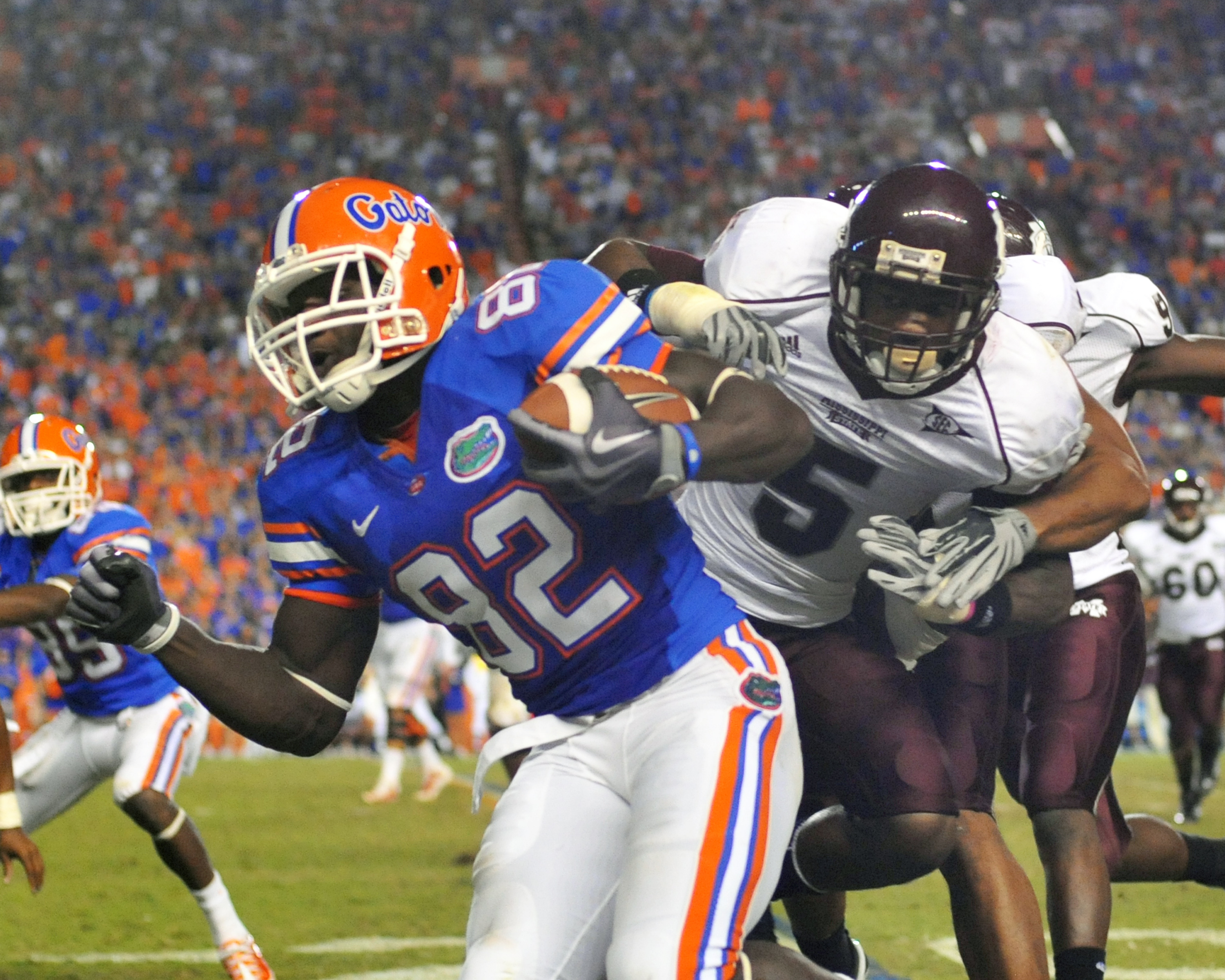 GAINESVILLE, FL - OCTOBER 16:  Wide receiver Omarius Hines #82 of the Florida Gators rushes upfield with a pass against the Mississippi State Bulldogs  October 16, 2010 Ben Hill Griffin Stadium at Gainesville, Florida.  (Photo by Al Messerschmidt/Getty Im