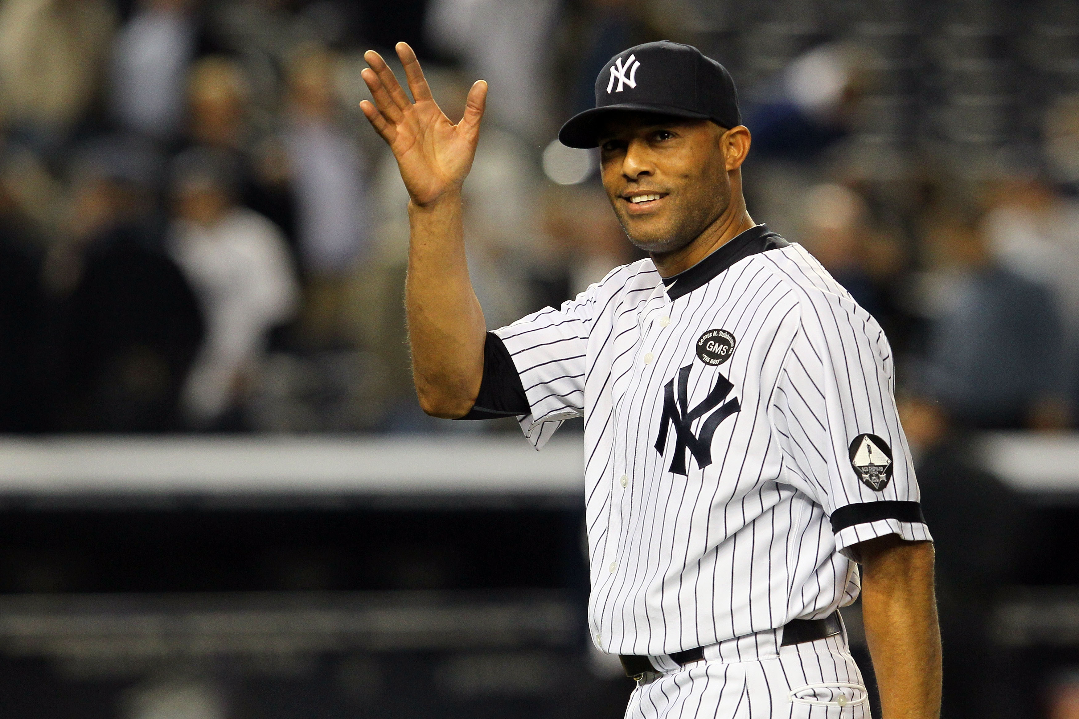 NEW YORK - OCTOBER 20: Mariano Rivera #42 of the New York Yankees celebrates after the Yankees won 7-2 against the Texas Rangers in Game Five of the ALCS during the 2010 MLB Playoffs at Yankee Stadium on October 20, 2010 in the Bronx borough of New York C