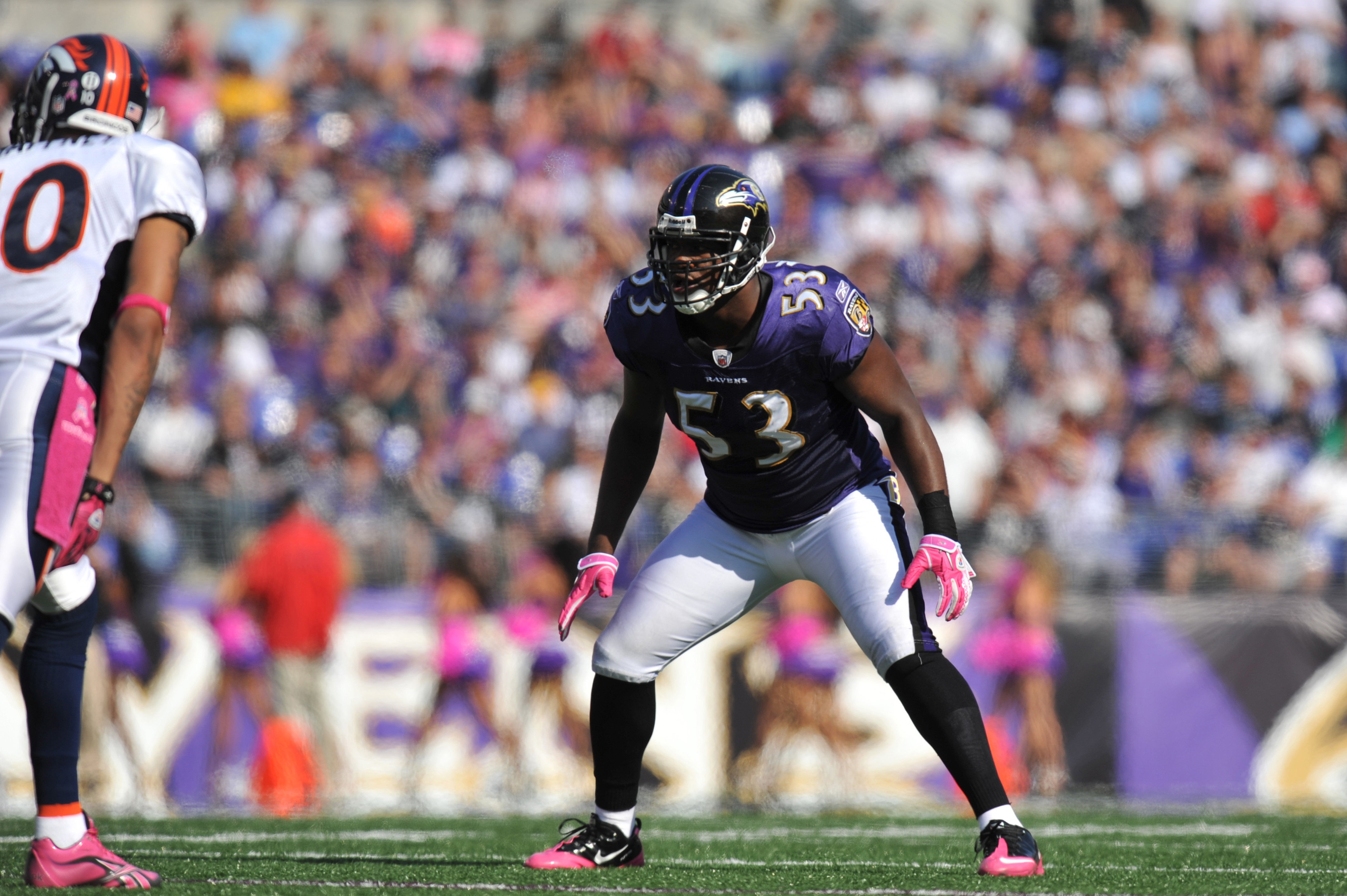 BALTIMORE, MD - OCTOBER 10: Ray Lewis #52 of the Baltimore Ravens defends against the Denver Broncos at M&T Bank Stadium on October 10, 2010 in Baltimore, Maryland. Players wore pink in recognition of Breast Cancer Awareness Month. The Ravens defeated the