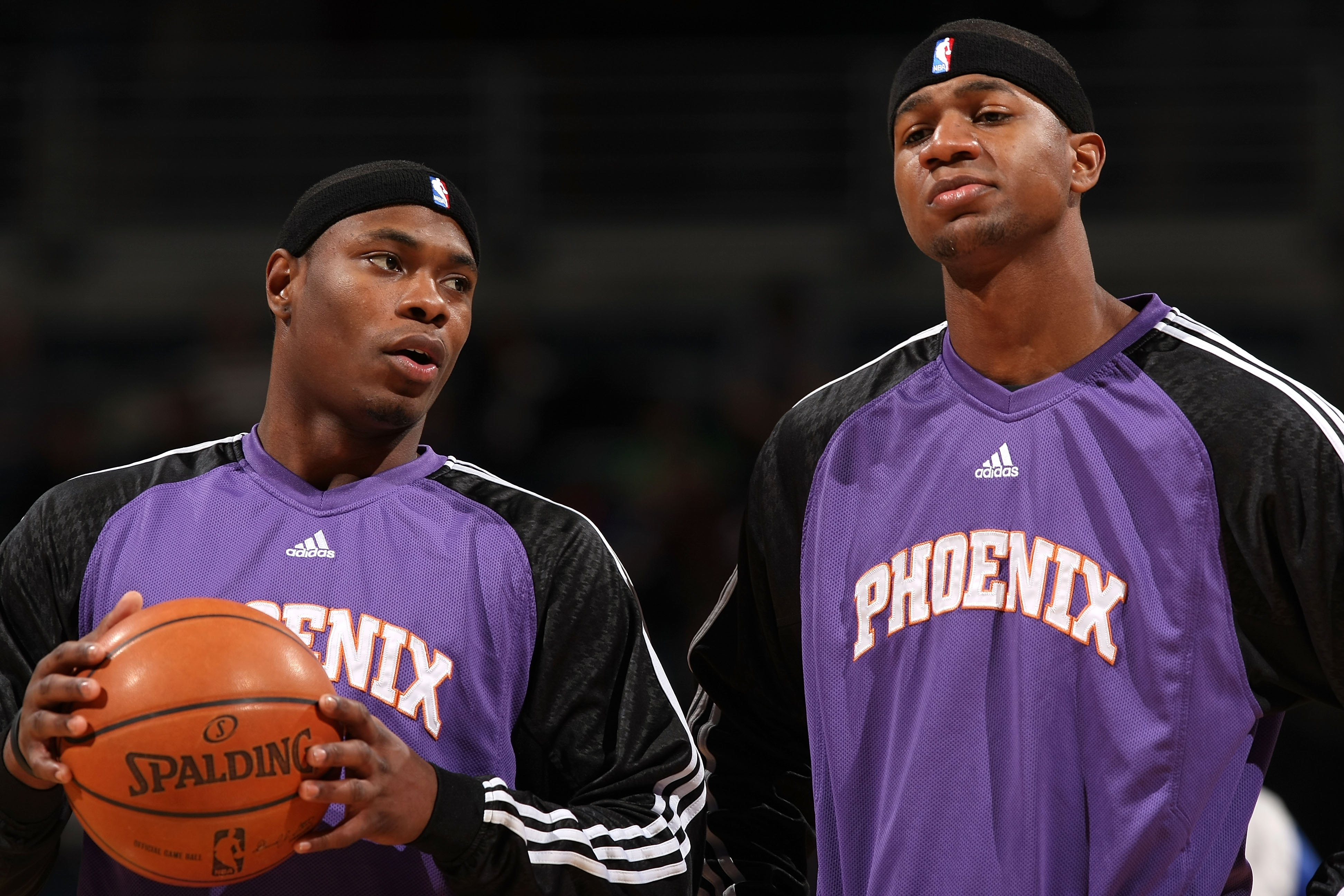 MILWAUKEE - JANUARY 22:  (L-R) Marcus Banks #2 and D.J. Strawberry #8 of the Phoenix Suns talk during warmups against the Milwaukee Bucks at the Bradley Center on January 22, 2008 in Milwaukee, Wisconsin. The Suns won 114-105. NOTE TO USER: User expressly