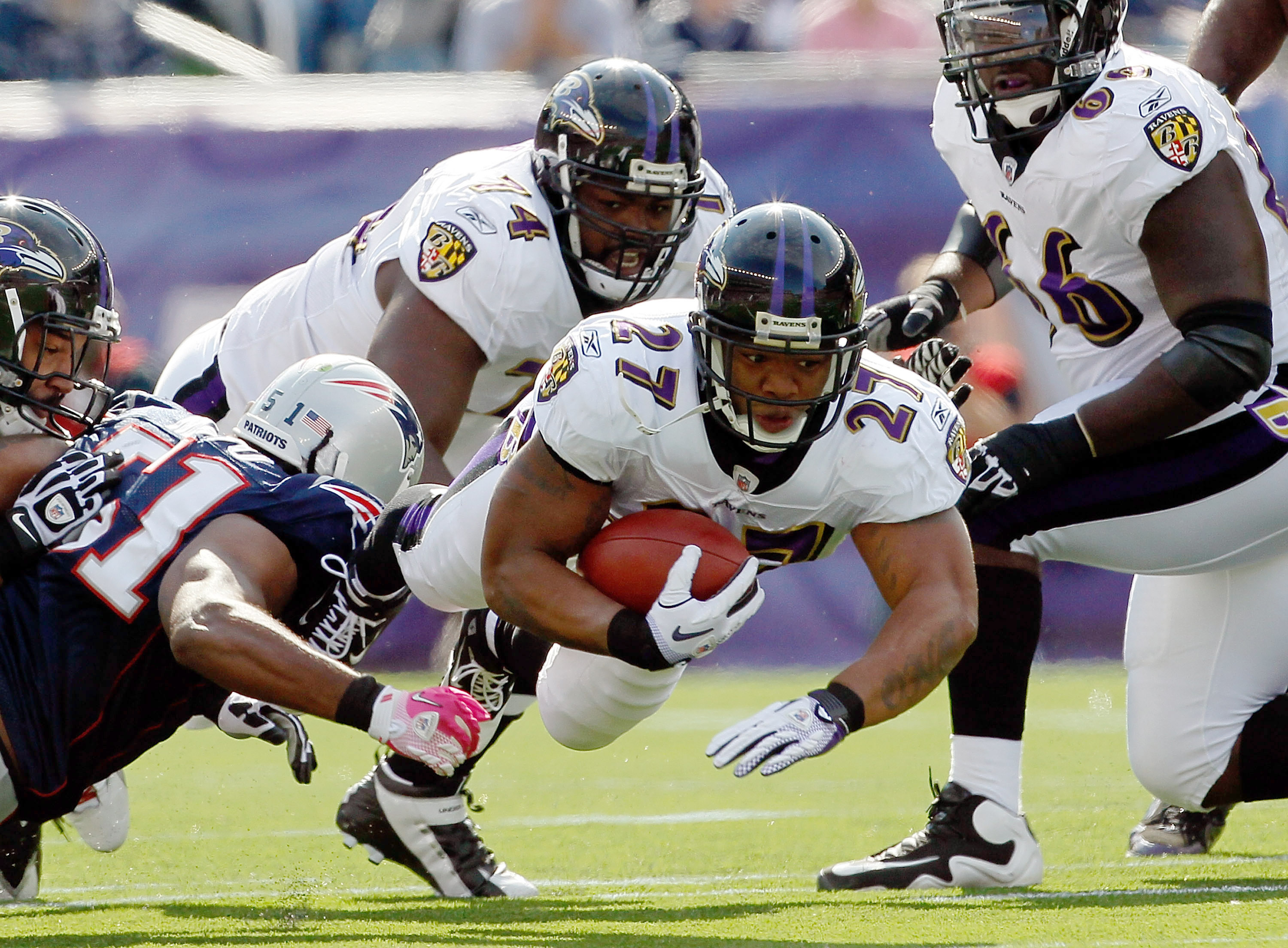 FOXBORO, MA - OCTOBER 17:  Ray Rice #27 of the Baltimore Ravens gains yards against the New England Patriots in the first half at Gillette Stadium on October 17, 2010 in Foxboro, Massachusetts. (Photo by Jim Rogash/Getty Images)