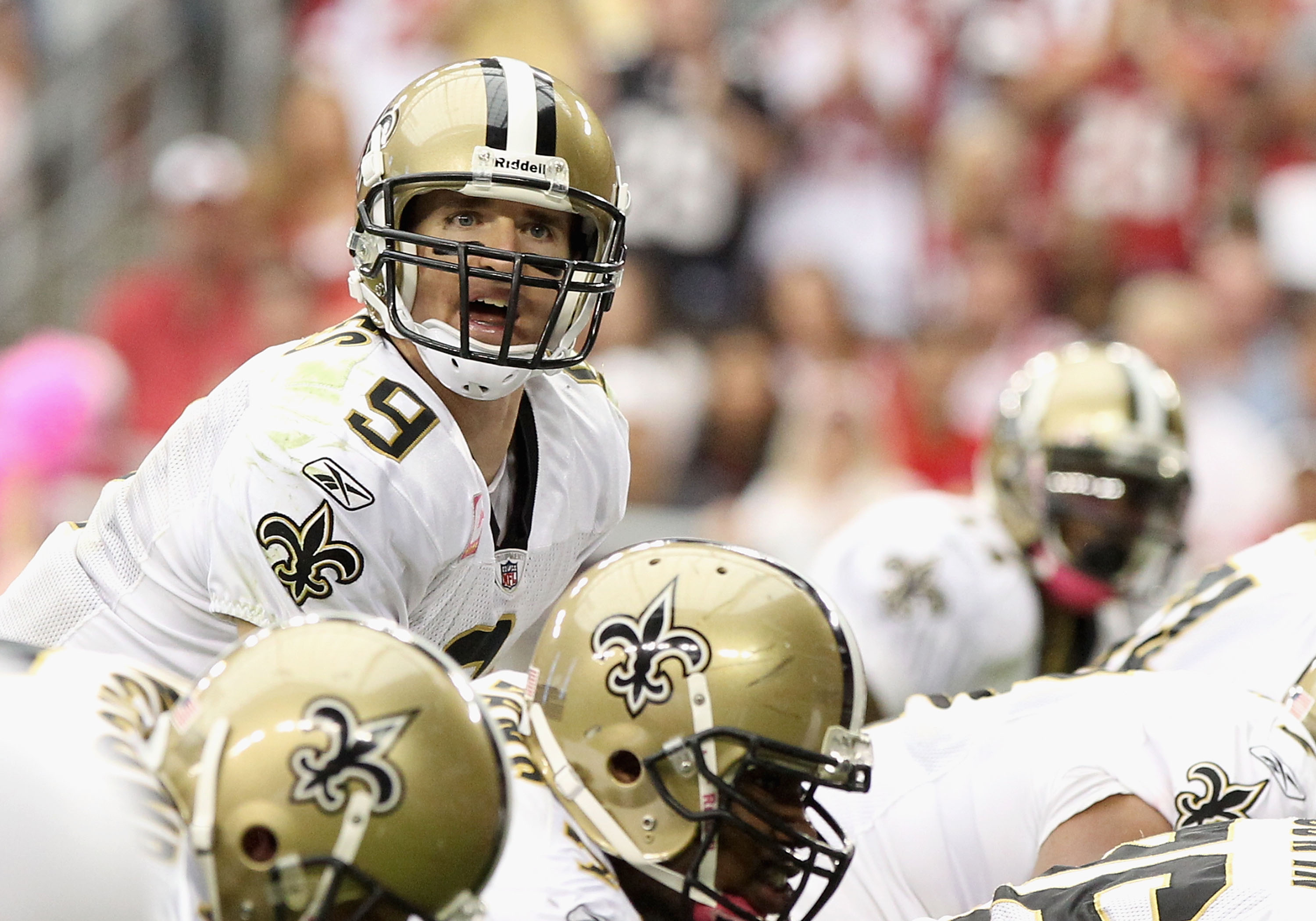 GLENDALE, AZ - OCTOBER 10:  Quarterback Drew Brees #9 of the New Orleans Saints prepares to snap the ball during the NFL game against the Arizona Cardinals at the University of Phoenix Stadium on October 10, 2010 in Glendale, Arizona. The Cardinals defeat