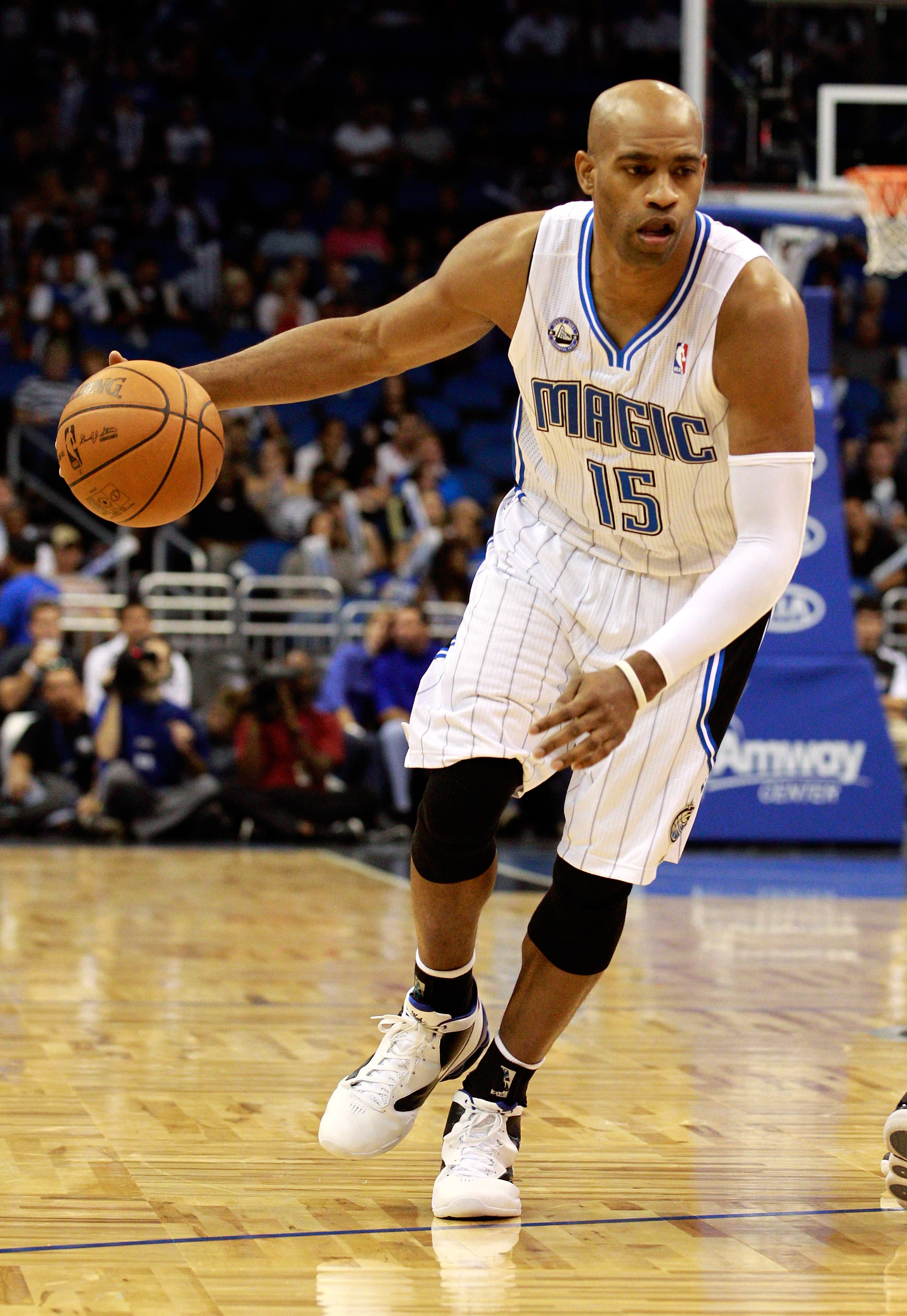 ORLANDO, FL - OCTOBER 10:  Vince Carter #15 of the Orlando Magic drives toward the basket during the game against the New Orleans Hornets at Amway Arena on October 10, 2010 in Orlando, Florida. NOTE TO USER: User expressly acknowledges and agrees that, by