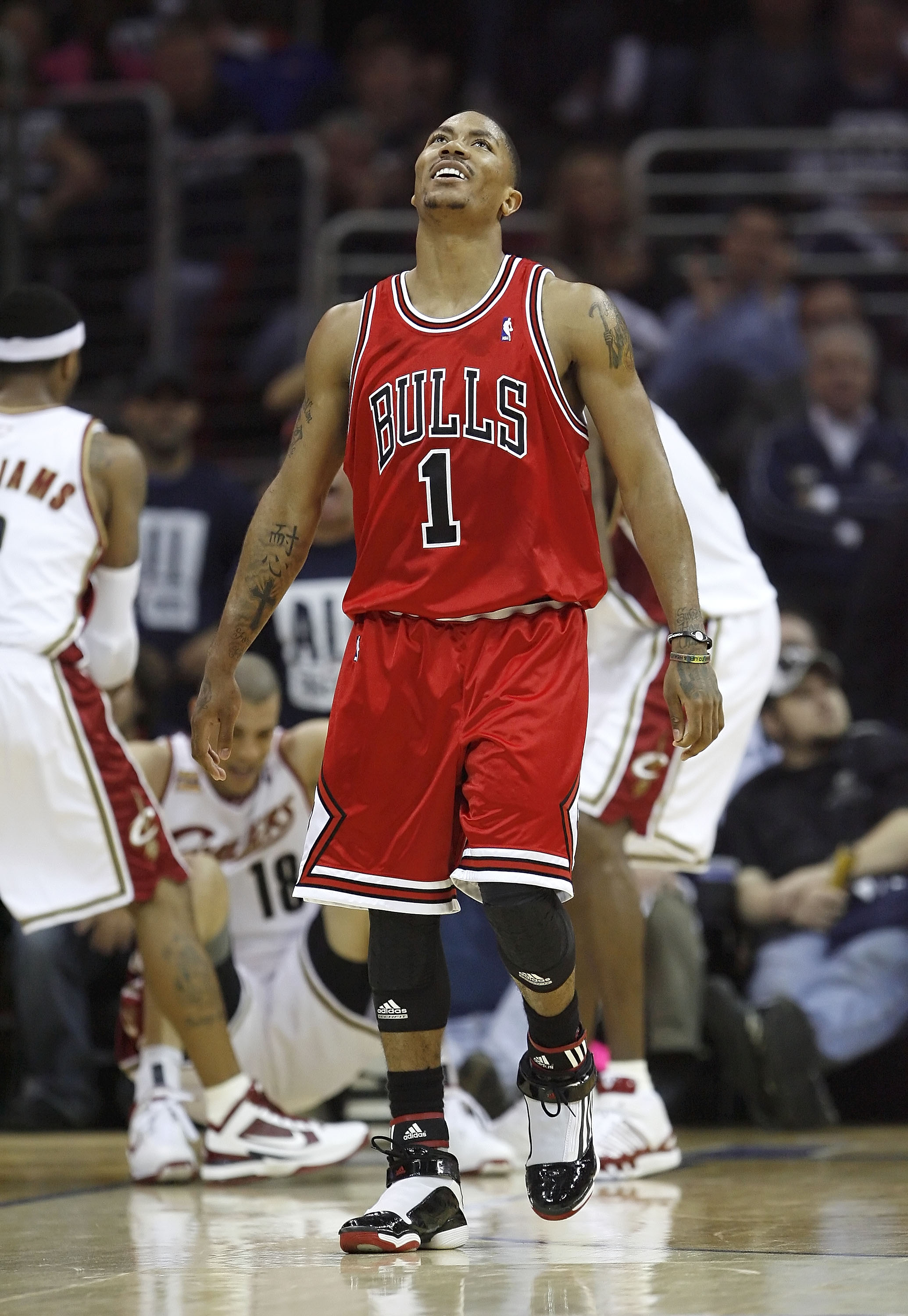 CLEVELAND - APRIL 17:  Derrick Rose #1 of the Chicago Bulls reacts after being called for a foul against Anthony Parker #18 of the Cleveland Cavaliers in Game One of the Eastern Conference Quarterfinals during the 2010 NBA Playoffs at Quicken Loans Arena