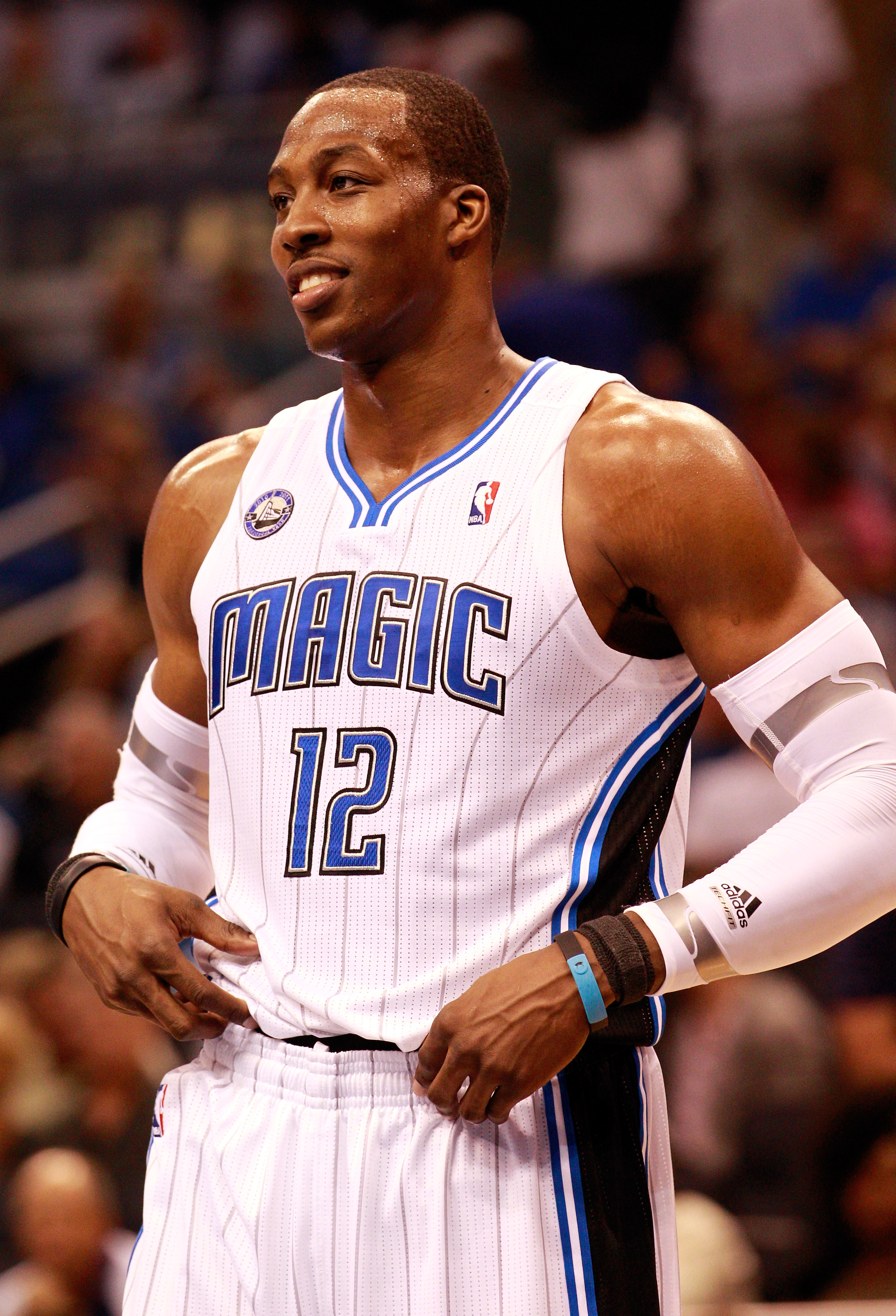 ORLANDO, FL - OCTOBER 10:  Dwight Howard #12 of the Orlando Magic smiles during the game against the New Orleans Hornets at Amway Arena on October 10, 2010 in Orlando, Florida. NOTE TO USER: User expressly acknowledges and agrees that, by downloading and