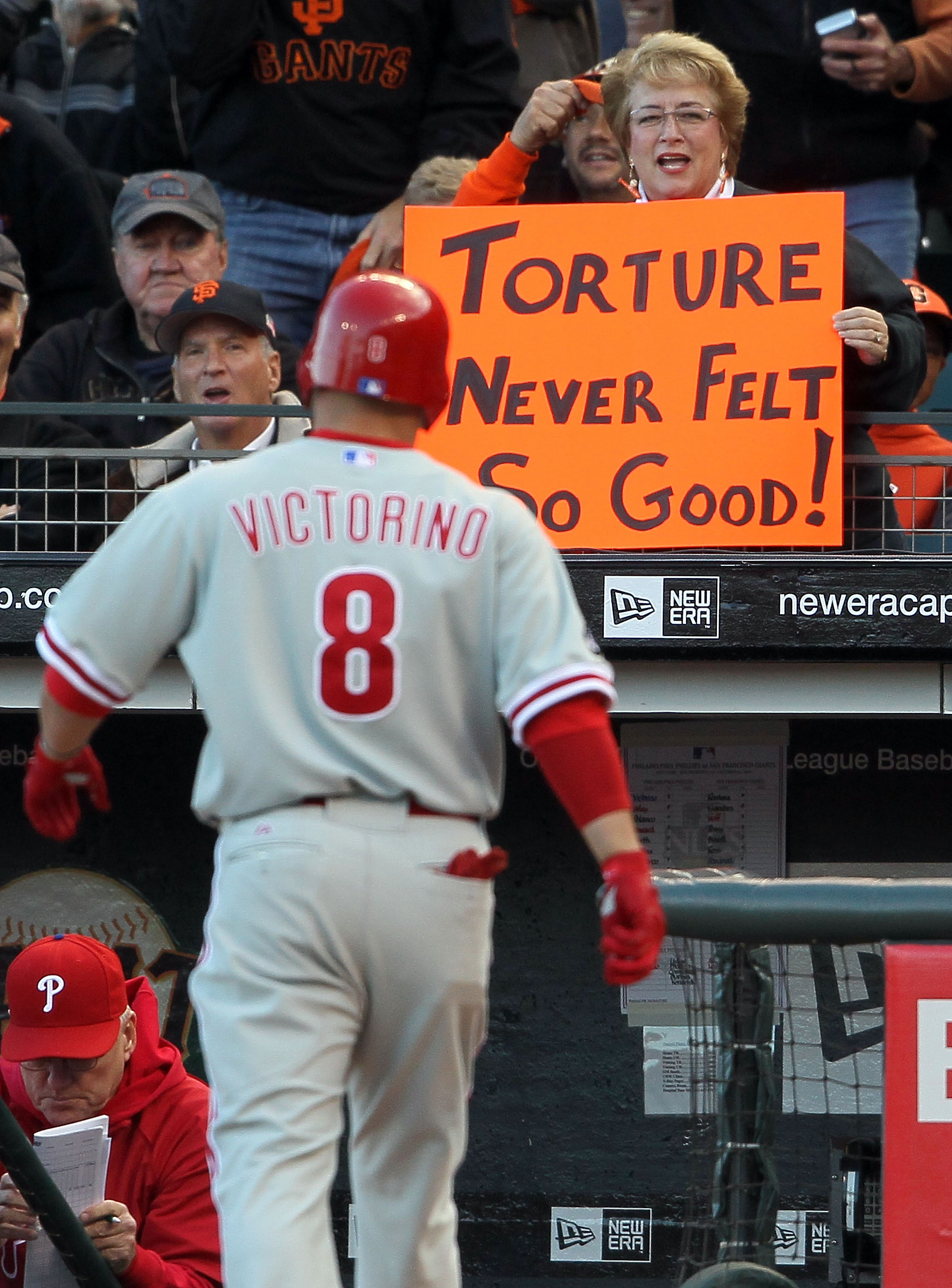 SAN FRANCISCO - OCTOBER 20:  A fan holds a sign as Shane Victorino #8 of the Philadelphia Phillies walks in to the dugout after striking out in the first inning against the San Francisco Giants in Game Four of the NLCS during the 2010 MLB Playoffs at AT&T