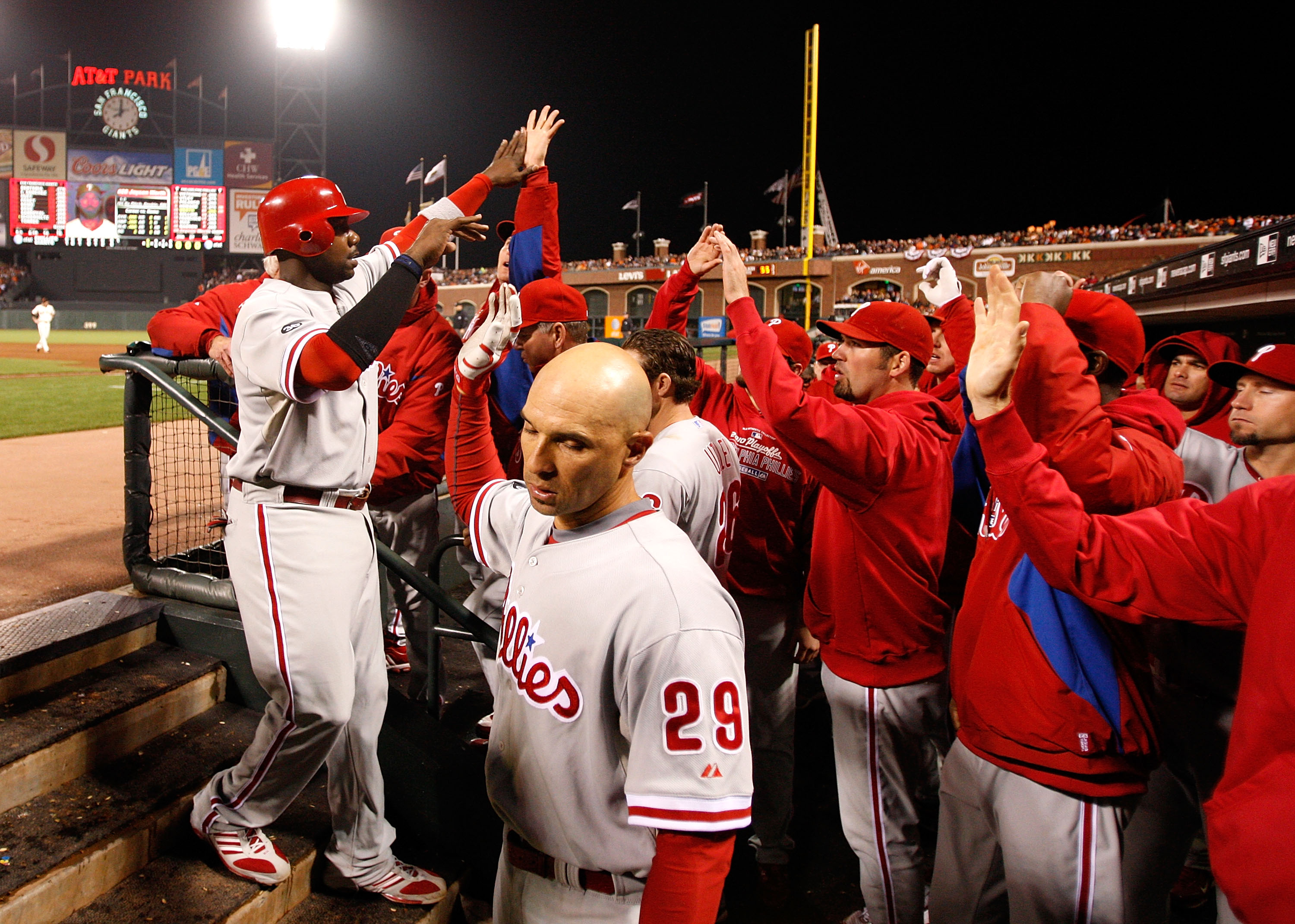 SAN FRANCISCO - OCTOBER 20:  Ryan Howard #6 of the Philadelphia Phillies celebrates in the dugout after scoring in the eighth inning against the San Francisco Giants in Game Four of the NLCS during the 2010 MLB Playoffs at AT&T Park on October 20, 2010 in