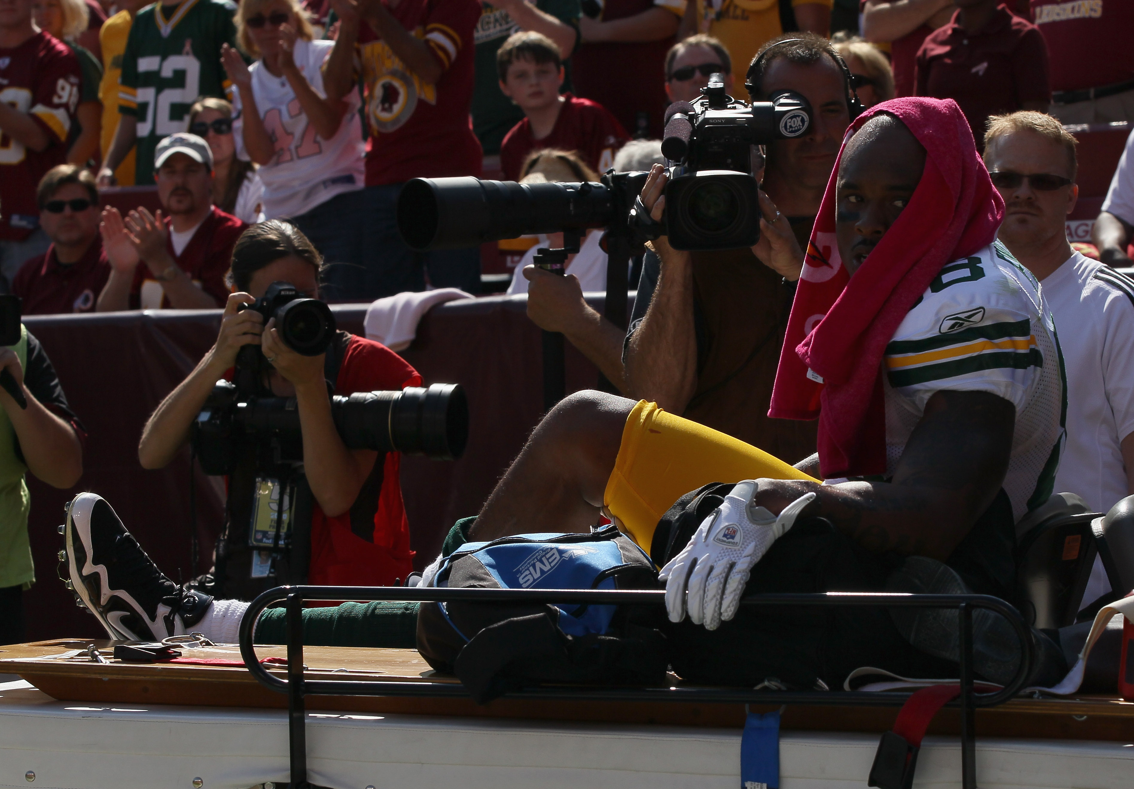 LANDOVER, MD - OCTOBER 10:  Tight end Jermichael Finley #88 of the Green Bay Packers leaves the game on a cart after injuring his knee against the Washington Redskins at FedExField on October 10, 2010 in Landover, Maryland. The Redskins won the game in ov