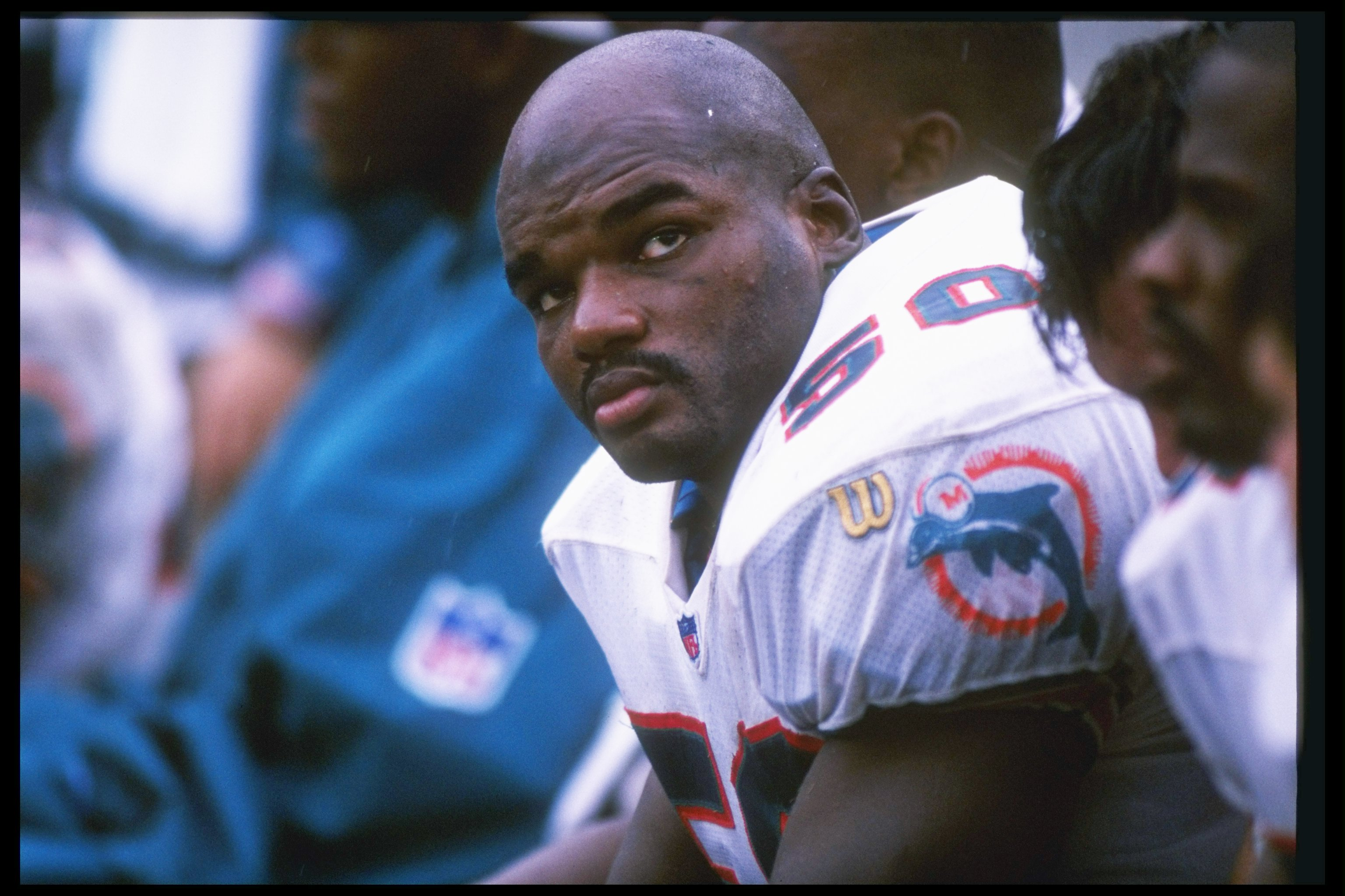 6 Oct 1996:  Linebacker Dwight Hollier of the Miami Dolphins sits on the bench during a game against the Seattle Seahawks at Pro Player Stadium in Miami, Florida.  The Seahawks won the game 22-15. Mandatory Credit: Andy Lyons  /Allsport