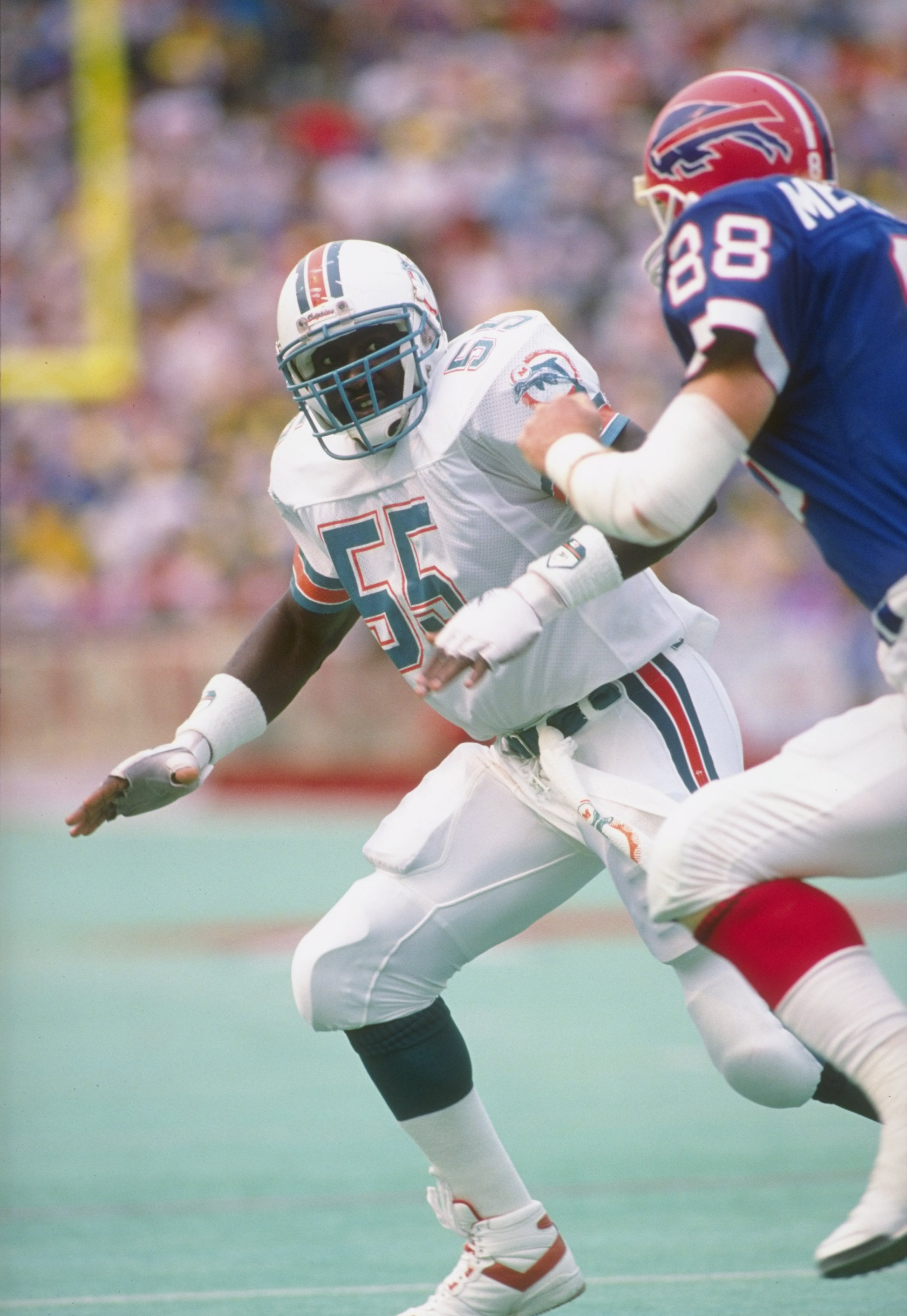 1 Sep 1991:  Linebacker Hugh Green of the Miami Dolphins (left) in action during a game against the Buffalo Bills at Rich Stadium in Orchard Park, New York.  The Bills won the game 35-31. Mandatory Credit: Rick Stewart  /Allsport