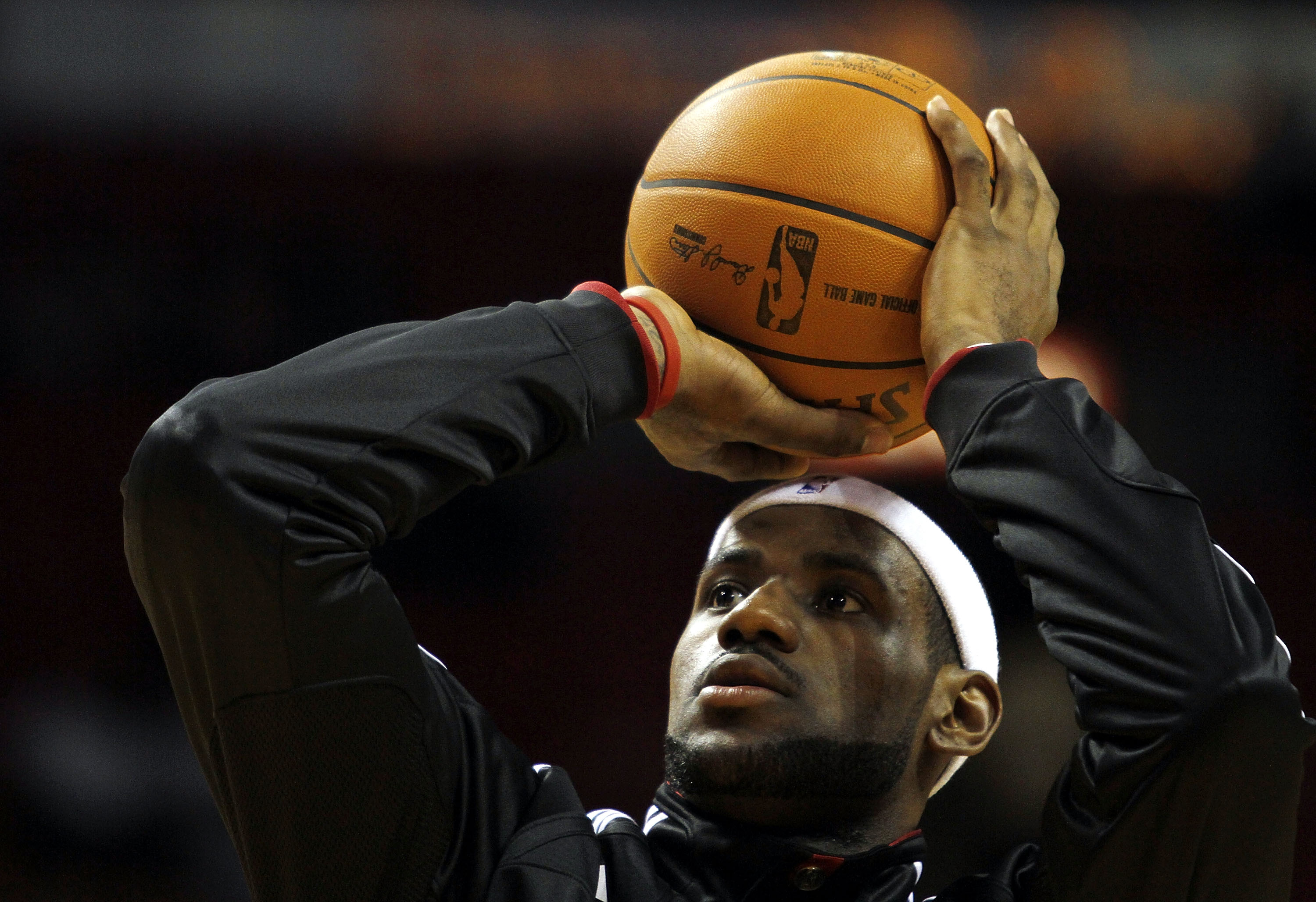 MIAMI - OCTOBER 18:  Forward LeBron James #6 of the Miami Heat prepares to face the Charlotte Bobcats on October 18, 2010 at American Airlines Arena in Miami, Florida. NOTE TO USER: User expressly acknowledges and agrees that, by downloading and/or using
