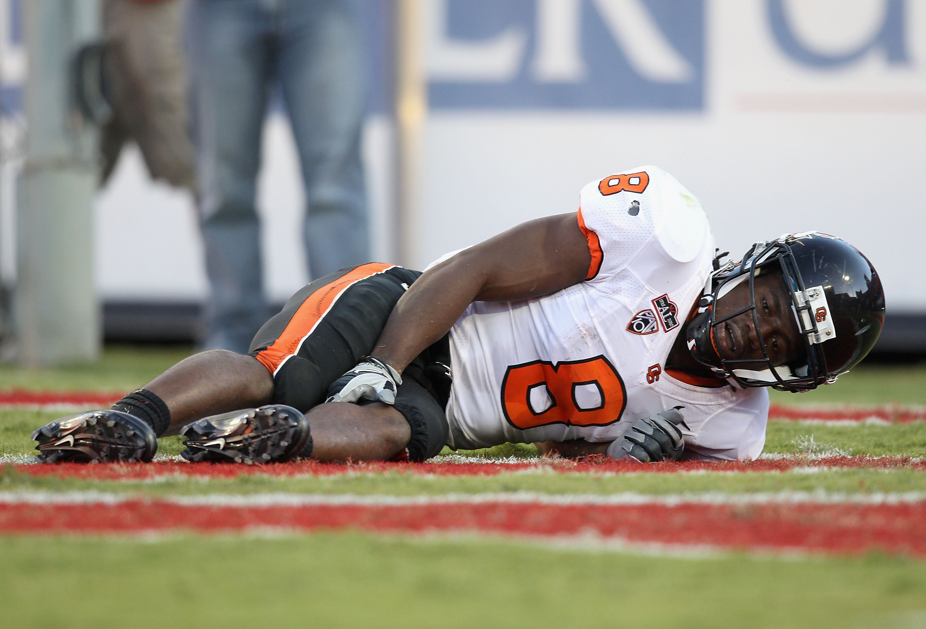 TUCSON, AZ - OCTOBER 09:  Wide receiver James Rodgers #8 of the Oregon State Beavers lays injured on the field during the college football game against the Arizona Wildcats at Arizona Stadium on October 9, 2010 in Tucson, Arizona. The Beavers defeated the