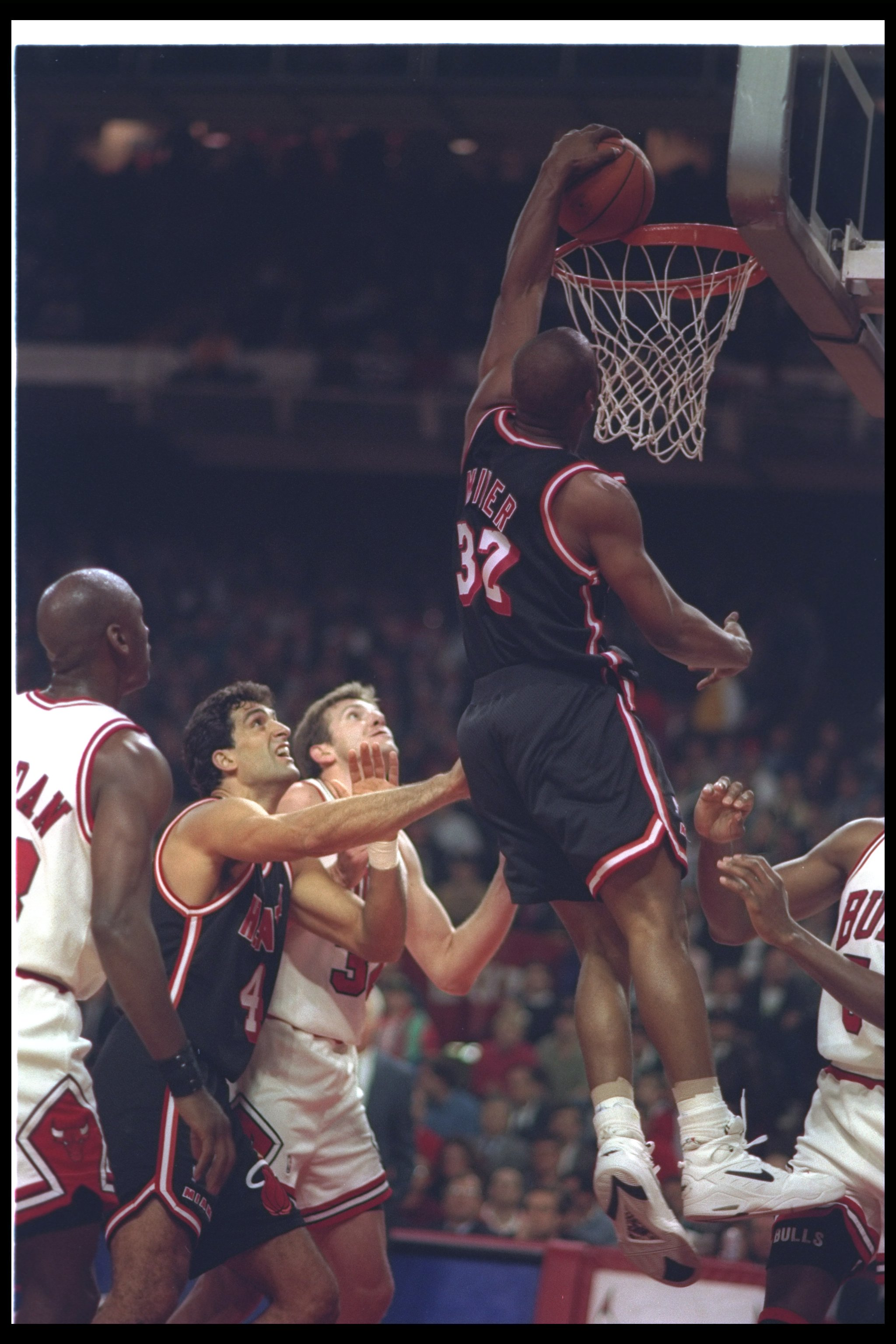14 Apr 1993:  Guard Harold Miner #32 of the Miami Heat sinks the ball during a game against the Chicago Bulls at the United Center in Chicago, Illinois. Mandatory Credit: Jonathan Daniel  /Allsport