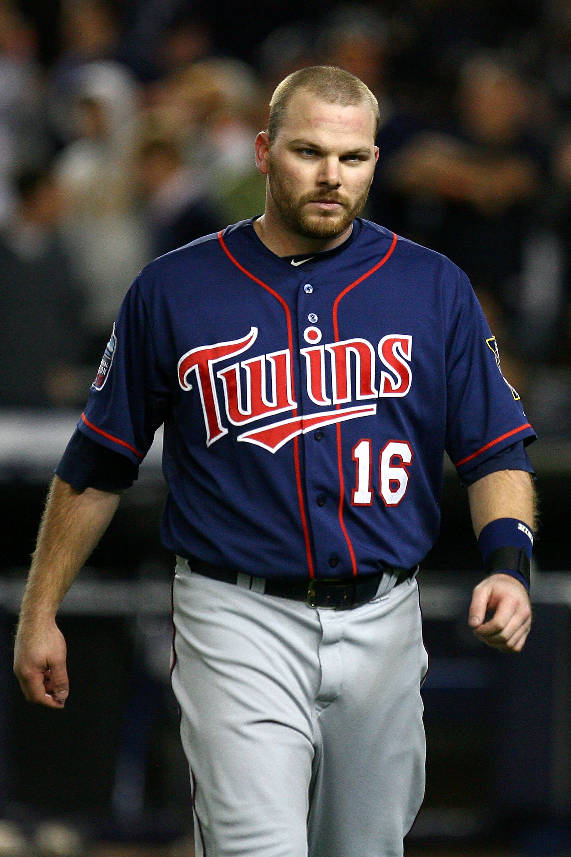 NEW YORK - OCTOBER 09:  Jason Kubel #16 of the Minnesota Twins reacts as he walsk back to the dugout after he struck out in the top of the sixth inning against the New York Yankees  during Game Three of the ALDS part of the 2010 MLB Playoffs at Yankee Sta