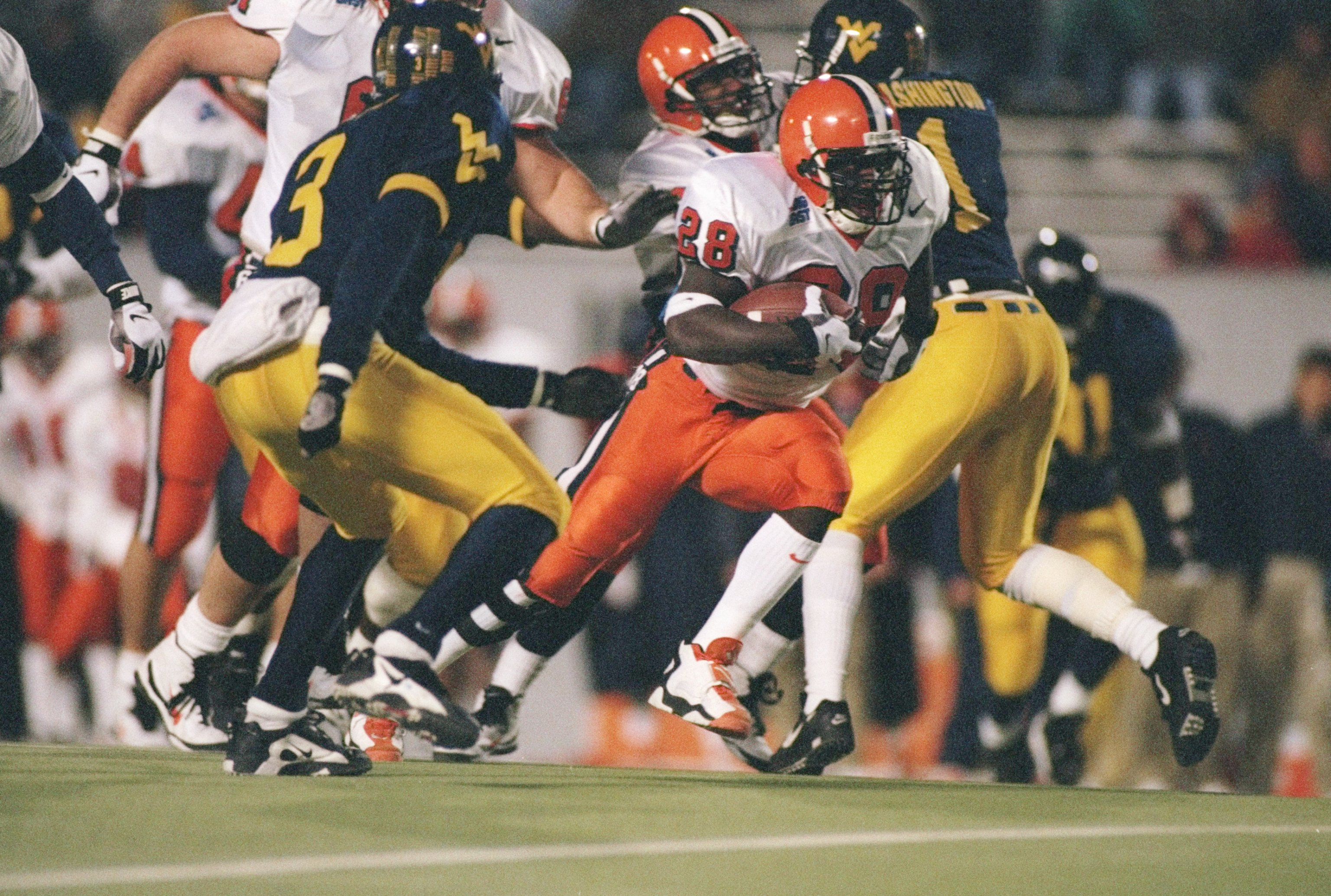 2 Nov 1996:  Tailback Kyle McIntosh of the Syracuse Orangemen runs with the ball during a game against the West Virginia Mountaineers at Mountaineer ield in Morgantown, West Virginia.  Syracuse won the game 30-7. Mandatory Credit: Jamie Squire  /Allsport