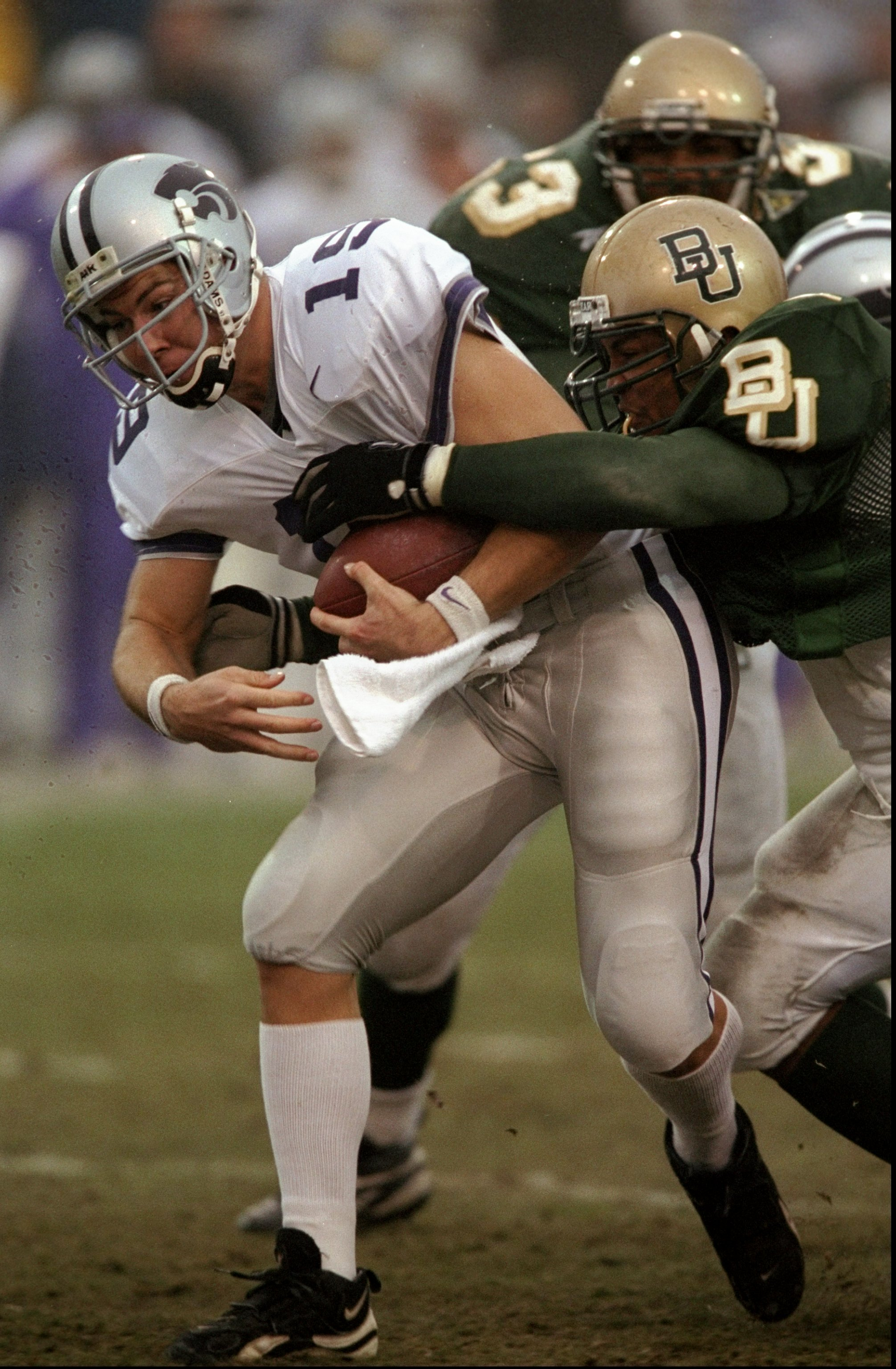 7 Nov 1998:  Adam Helm #19 of the Kansas State Wildcats is tackled by a member of the Baylor Bears during a game at the Floyd Casey Stadium in Waco, Texas. The Wildcats defeated the Bears 49-6. Mandatory Credit: Stephen Dunn  /Allsport