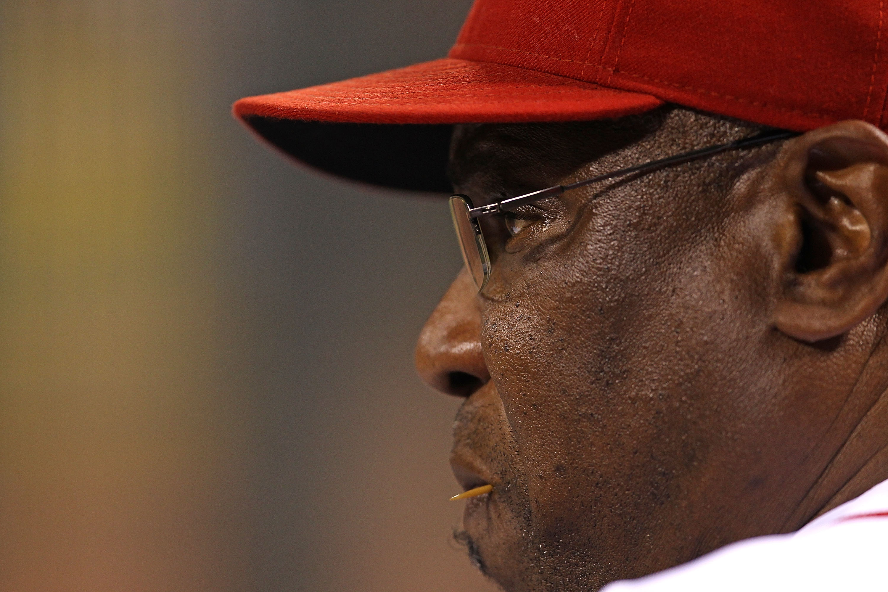 CINCINNATTI - OCTOBER 10: Manager Dusty Baker #12 of the Cincinnati Reds watches as his team takes on the Philadelphia Phillies during game 3 of the NLDS at Great American Ball Park on October 10, 2010 in Cincinnati, Ohio. The Phillies defeated the Reds 2